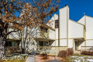 Stunning Racquet Club residence with golf course views!