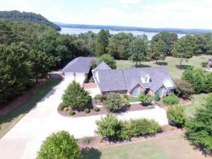 Summer is on the way!  You know you would LOVE to be on the LAKE! Your family will enjoy the convenience of this home.  Complete with it's own PRIVATE boat dock with a lift on Lake Dardanelle's Piney Bay! This wonderful custom built, energy efficient home includes a HUGE 30x30 detached double garage and workshop/Mother in Law quarters. Enjoy the wonderful scenes of nature from the sunroom or the oversized deck! This one is definitely better viewed in person. Call  today and schedule a showing!