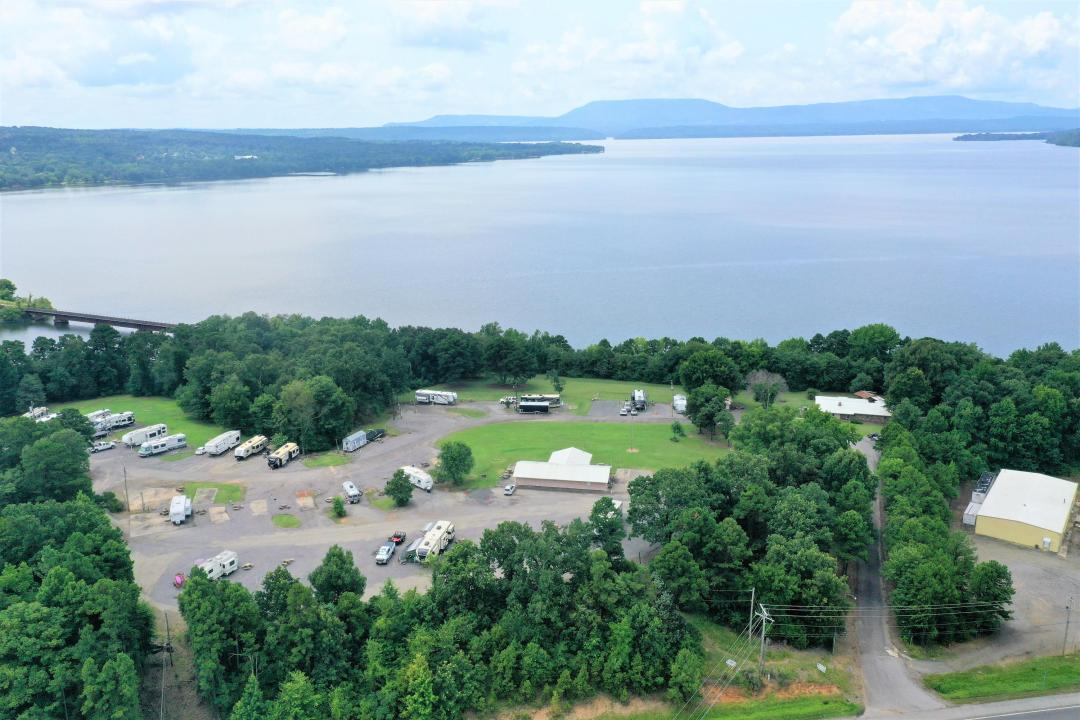 Off of Exit 78 and bordering Lake Dardanelle, you will find 12 panoramic acres perfect for your next business venture or investment opportunity. This unique and beautiful property is currently used as an RV park with 45 hook up locations, an office, laundry/restroom & shower facilities, two houses, and a commercial warehouse. Being close to Russellville, Arkansas Nuclear One, and I-40, this spot could be ideal for literally anything! The views of Lake Dardanelle and Mount Nebo from the park will leave your visitors consistently coming back for more. The building and land below the RV Park are conveniently located right off the interstate and has traffic volume that could lead to high returns on investment