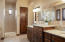 Large master bath with separate shower and tub and two sinks.