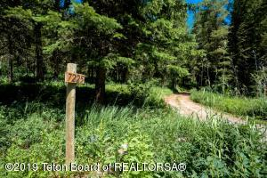 Driveway entrance off of Trail Creek Road is in NFS - license in place from NFS.