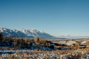 Gorgeous Teton view from 1000 ft. above the valley floor makes Spring Creek Ranch a truly special and one-of-a-kind resort