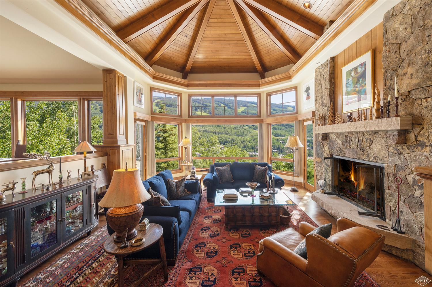 Perched above Vail Village, this exceptional home has panoramic views of Vail Mountain. With four bedrooms, five bathrooms and an excellent floor plan, the abundant sunlight making it warm and inviting. Ideal for families and entertaining, this home has an expansive kitchen, dining room, family room with wet bar, climate controlled wine room, and beautiful outdoor stone decks overlooking Vail Village and Vail Mountain.