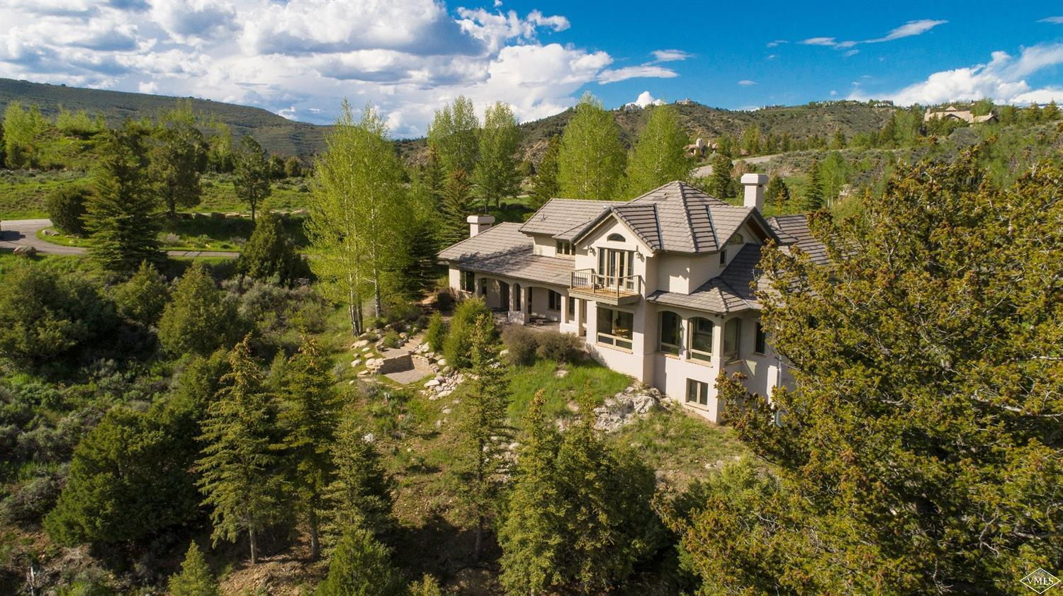 Stunning views from every room in this classic ridge line home, situated just inside the Divide and only 10 minutes from Riverwalk. A fabulous 4-bedroom home and one of Cordillera's most treasured residences.