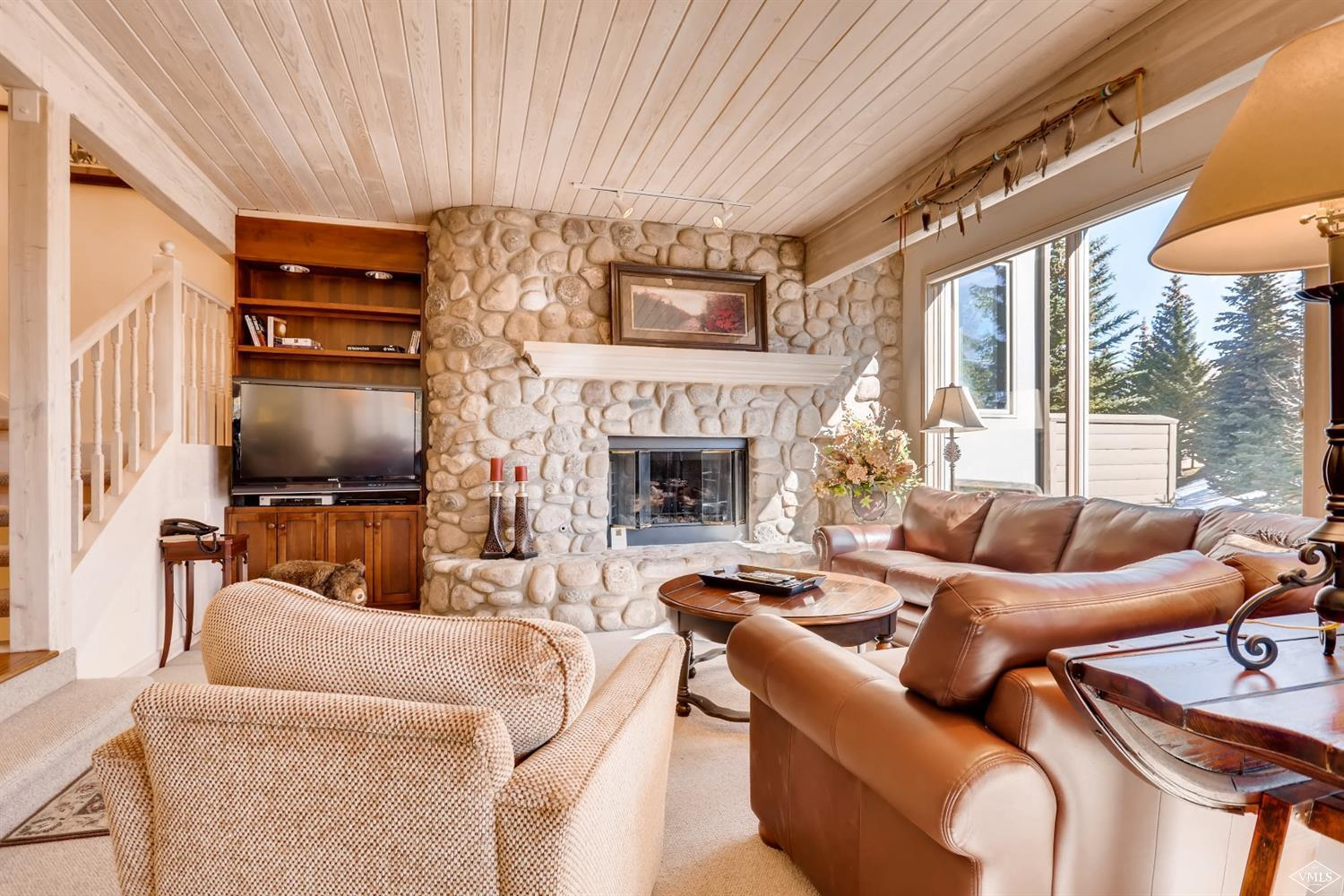 Rare end location residence with additional windows, plenty of natural light, and views. Secluded forest setting and just minutes from the Vail Village. The large kitchen and bedrooms, with a spacious multi-level floorplan make it perfect for a large family and entertaining. Inviting outdoor space with private patio and hot tub as well as an upper level balcony with mountain views.