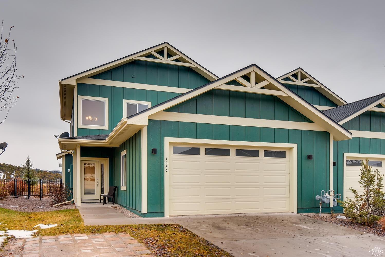 Main level master 3 bedroom duplex with a nice fenced yard. Large bedrooms, additional living area upstairs, oversized 2 car garage, wonderful views of the surrounding mountains. Ready to move in.