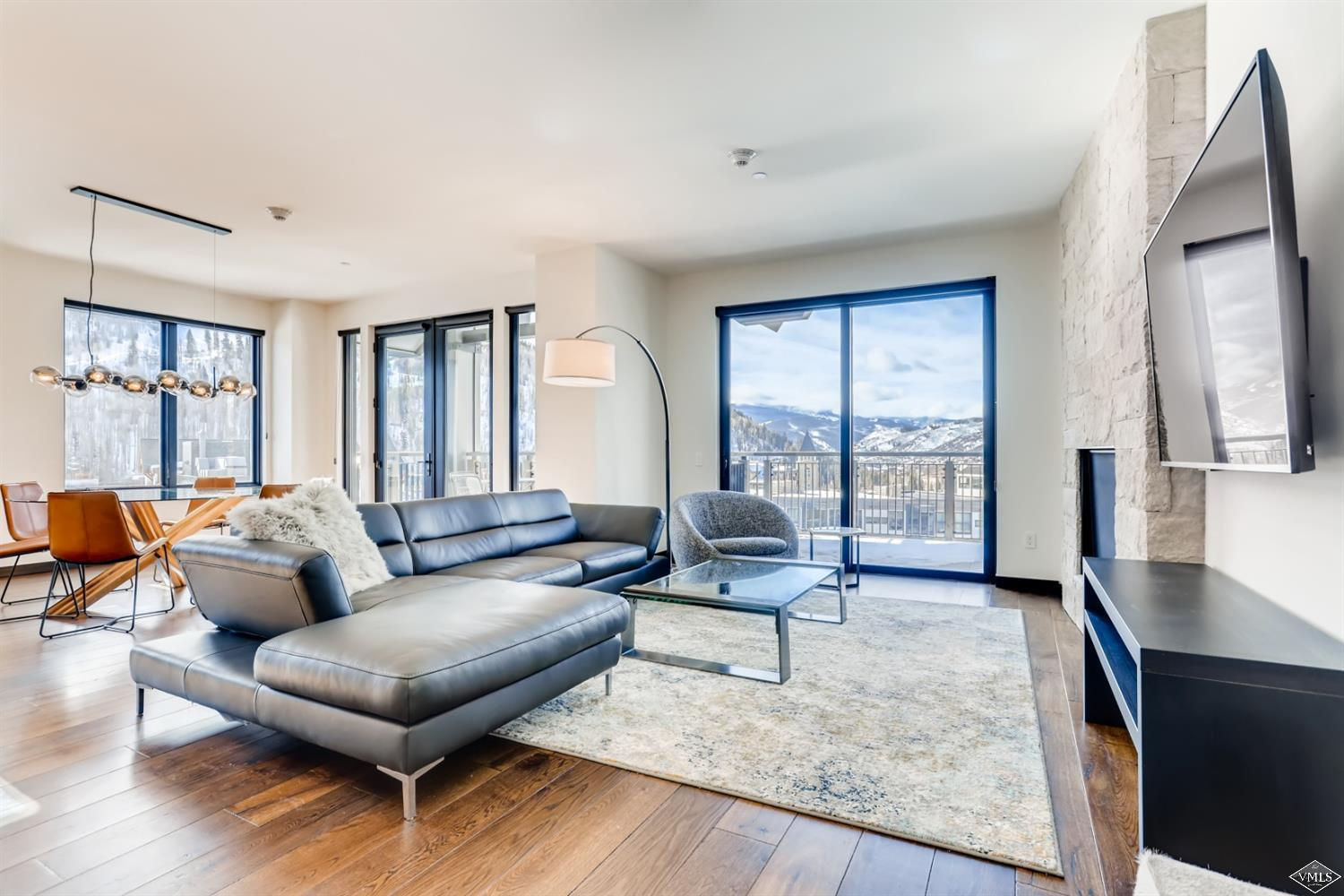 This Southwest facing, spacious 3-bedroom corner residence features high-end, contemporary finishes, and 3 large decks with panoramic Vail mountain and sunset views. Luxury amenities include ski concierge, fitness center, and on-site management.