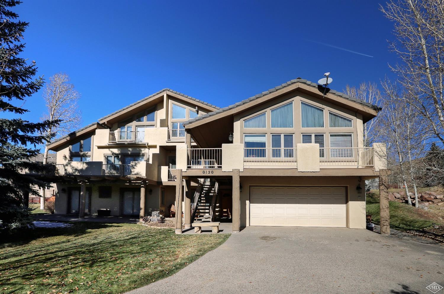 One of the best priced 4-bedroom homes in Singletree. Duplex with separate drive on quiet street, close to community center and park. Enjoy multiple decks, great lighting and mountain views.