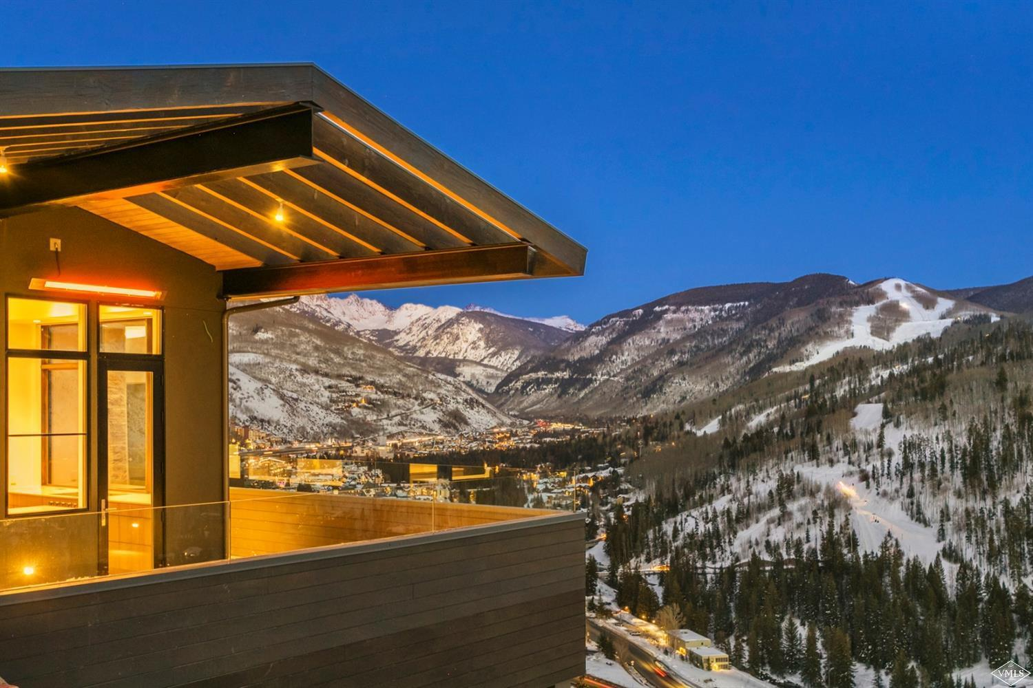 Vail's newest mountain luxury home with out of this world elevated views of the Gore Range, Vail Mountain and all the way to Beaver Creek. An open floor plan with double-sided gas fireplace ensures your family the quintessential modern lodge experience. Plus an outdoor fire pit and plunge pool to relax after a full day of mountain activities. Visit ClifftopVail.com/?mls to learn more.