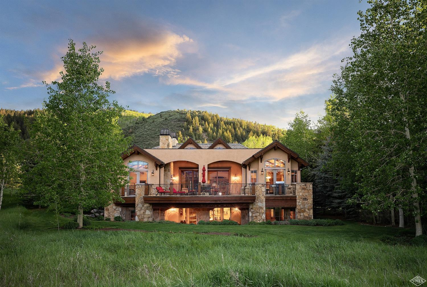 Invite the outdoors in with sliding glass walls opening to majestic mountain vistas over the 5th fairway of the Country Club of the Rockies golf course. Featuring an exquisite custom bar, bunk room, apartment, walkout lower level and a hidden safe or gun room.