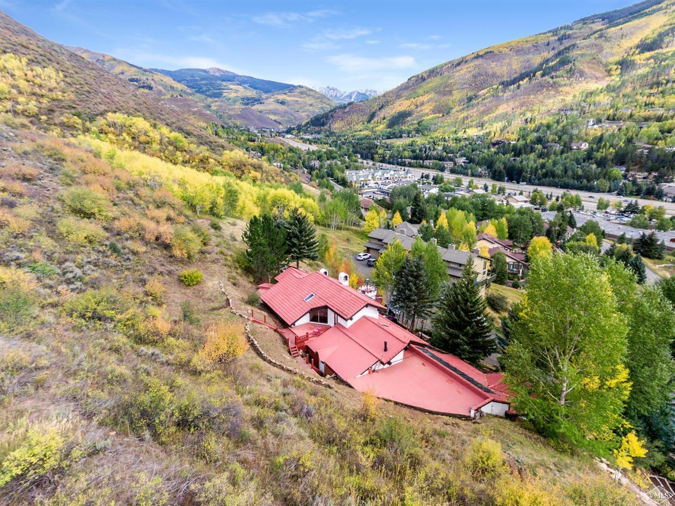 Truly one of West Vail's most stunning homesites with jaw dropping views to the Gore Range. Situated next to Forest Service land this home is an ideal candidate for an update that would make the envy of any home from East Vail to West Vail. Zoned for a Primary and a Secondary dwelling this has so many options to make it your private special Vail home.