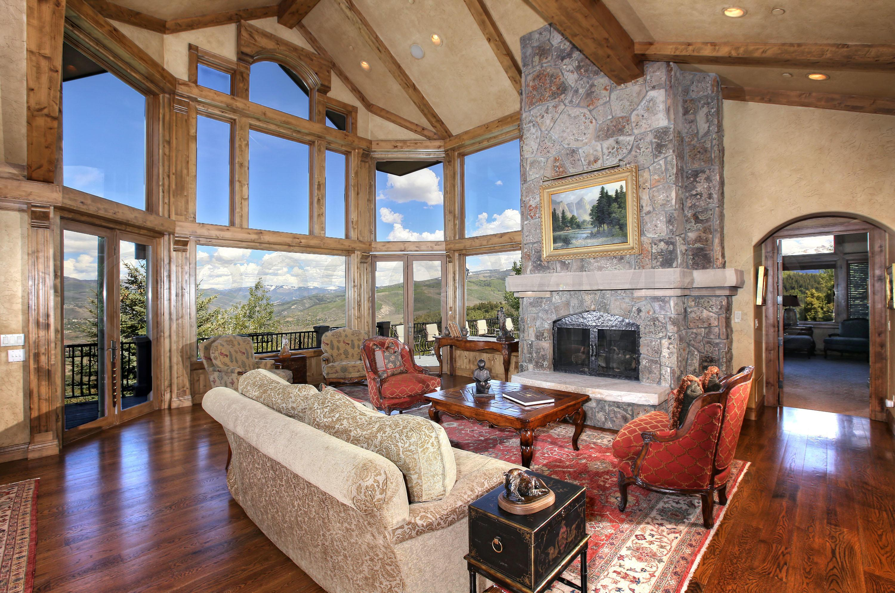 This spectacular Cordillera custom residence has it all with magnificent and unobstructed Gore and Sawatch Range views, beautiful handcrafted finishes, six spacious ensuite bedrooms, generous family living areas, private study and wonderful outdoor patios and decks. A dramatic great room with custom floor to ceiling stone fireplace, gourmet kitchen and a large hearth room all compliment a remarkable mountain estate. Located close to the Short Course. This residence is a must see.