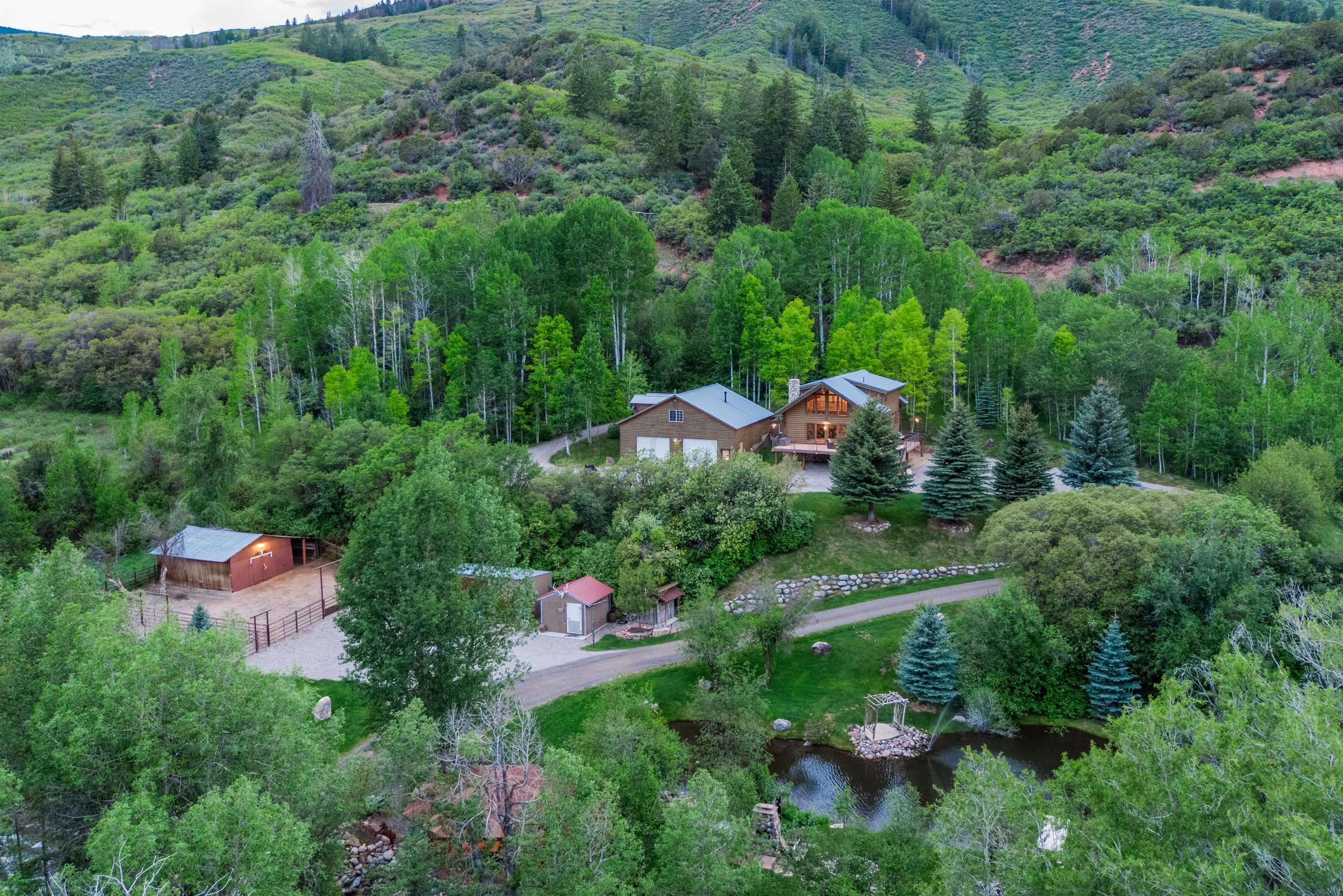 Enjoy this slice of Colorado heaven in Eagle, Colorado privately located on the Brush Creek River. Live the ranch lifestyle on 7.7 acres with nearly 350 feet of creek frontage, a serene pond and a spring with incredible water quality to use for drinking, ponds and irrigation.  Enjoy true Colorado living that is only about 1 mile from country club amenities at the Frost Creek Country Club.  Take in rounds of golf at one of the most beautiful private golf courses in the world, enjoy a day at the spa, or sit by the pool, play tennis with family and friends.  Get into the more rugged fun and fly fish on your own land, four wheel or snowmobile off property down the road to National Forest, fish or swim in the pond, tube down the creek...the options are endless.  Close and easy access to Forest Service and BLM. This property also has excellent hunting access and a walk in cooler. After a long day of fun, ride your golf cart or bikes to enjoy dinner at the club restaurant or to have cocktails on the patio.  Better yet, return to your ranch to have drinks by the creek gazebo.  This land is truly special.  It is a place where your kids or grandkids get married kind of special.  Anyone recognizes that the moment they arrive.  The main house is a gorgeous log cabin.  The great room overlooks the beauty of the outdoors out to the expansive wrap around deck and a game room that would make a cowboy proud.  Seamlessly entertain from the indoors to outside on the deck.  Wind down the night by the outdoor fire pit and make s'mores with the kids and reminisce about the day telling stories.  This home is for people ready to truly live the good life.  This property has so many types of buyers it is hard to know what to describe. Go to mls.VailValleyRanch.com for many more details.