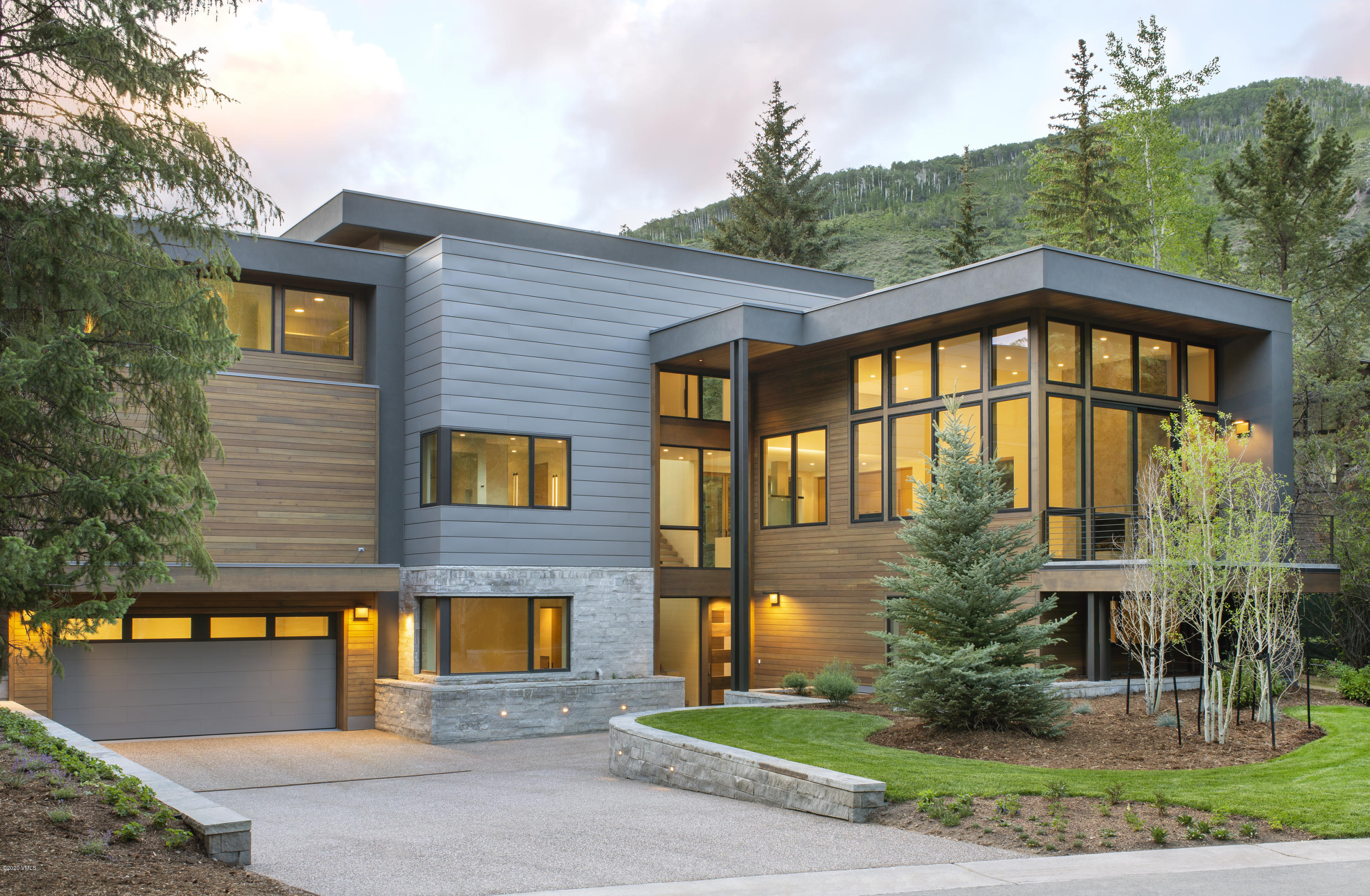 Beautiful, contemporary new construction on the Vail Golf Course. Enjoy the tranquil views from the floor to ceiling windows in the Living Room, as well as the terrace off the kitchen with a recessed hot tub. Wolf & Subzero package, radiant in-floor heating, zoned AC, snowmelt driveway. Enjoy the short walk to Vail Village or catch a ride on the Golf Course Bus Route for easy access. Secondary side of the duplex, with the Primary (1012 Eagles Nest Circle) available as well.