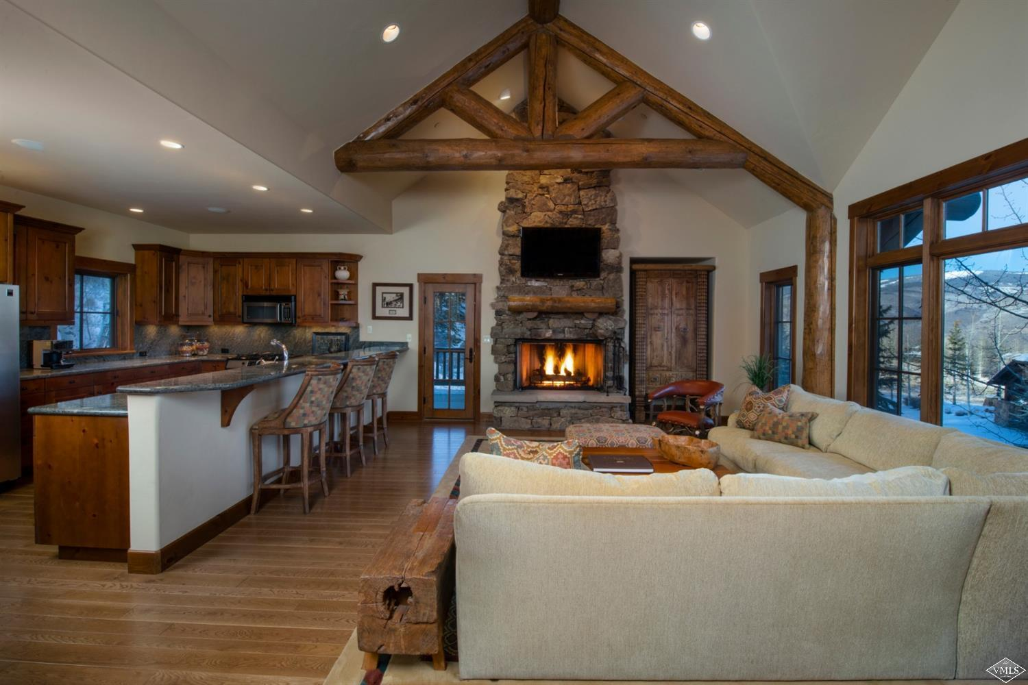 Opportunity to own the most reasonably priced single-family home within this exclusive resort offering panoramic views of the Gore Range and Game Creek Bowl. Easy ski access from Cold Snap ski-way with a comfortable open floorplan and over-sized family/game room. Main level master and three guests rooms on the lower level for separation and privacy. Two-car garage; private hot tub. Located in a small popular enclave.