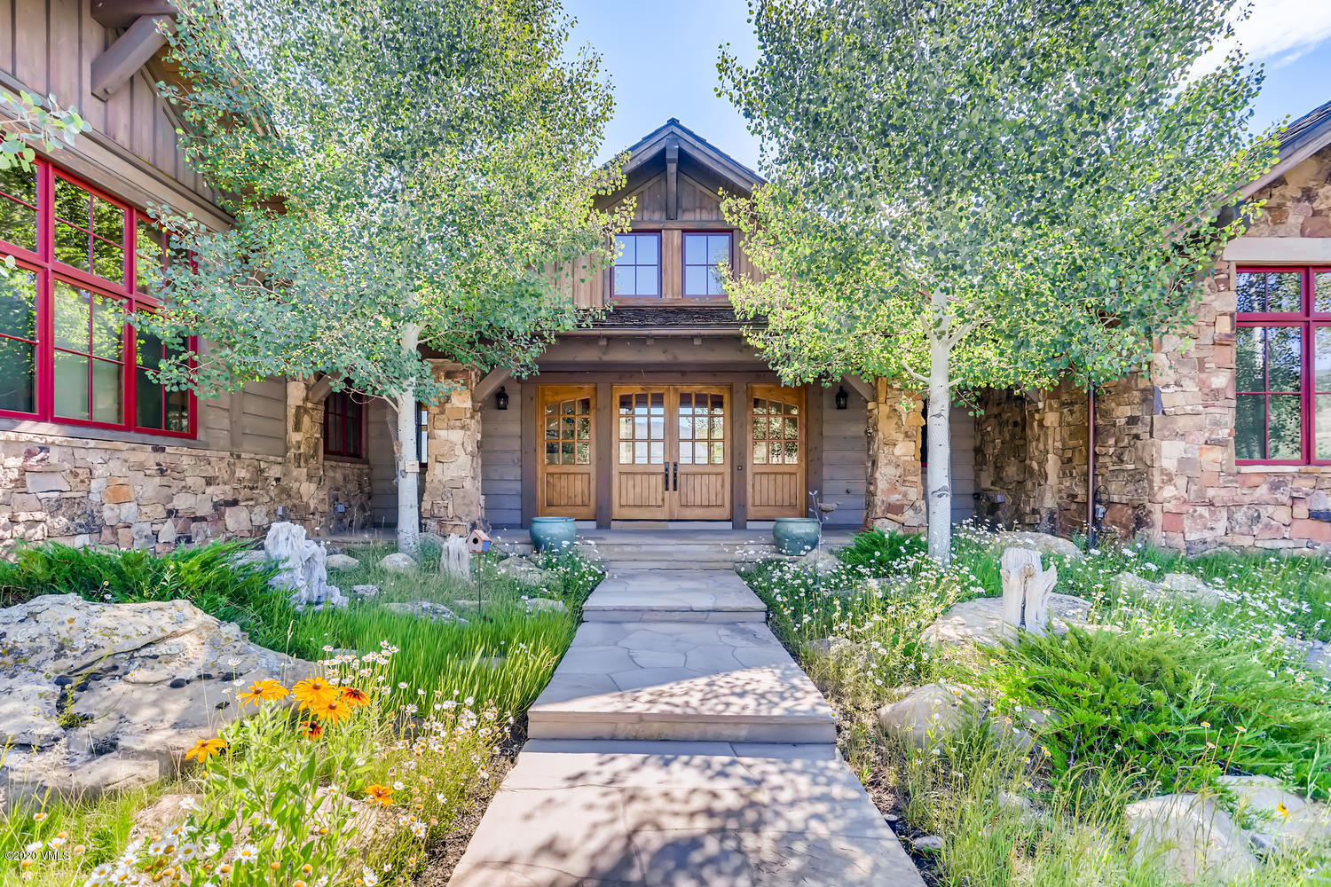 Inspired by the Austrian Alps, with views of the Rocky Mountains, this sun-drenched custom home features rustic, hand-hewn Oregon fir beams, European oak flooring, and a central kitchen with artistically distressed cabinetry and a Bavarian-inspired nook. This downsizer's dream is located in the exclusive community of Red Sky Ranch and also includes single floor living, vaulted ceilings, open great room/kitchen, lockoff, covered patio with outdoor fireplace, and ski slope views of Beaver Creek.