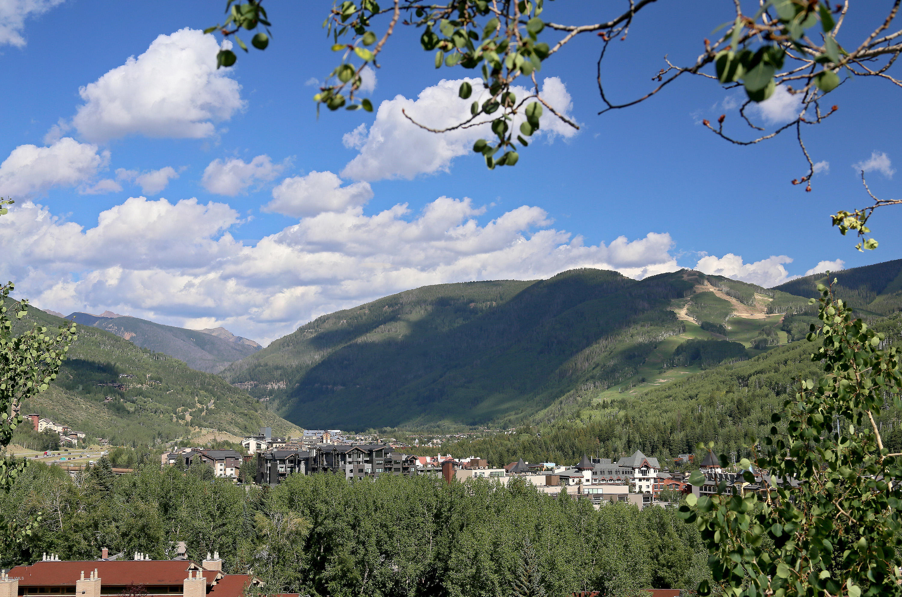 This fully remodeled and furnished, 2-bedroom, 2-bathroom home is located on the desirable sunny side of the Vail Valley. The top floor unit with vaulted ceilings throughout, an open floor plan and floor to ceiling windows gives the sense of your own sanctuary and a feeling of greater spaciousness. The view from the living room of the Vail Mountain is absolutely breathtaking.  Make this your home whether you are a full-time owner, front range buyer or looking for a property with consistent rental income. This location, away from the highway noise, provides for an easy access to skiing, hiking trails, shopping and dining.  Other benefits include a covered parking, washer/dryer in the unit, 4 storage closets, new hot water heater, a large community storage beneath the building, low HOA monthly fee with a quality and timely maintenance.