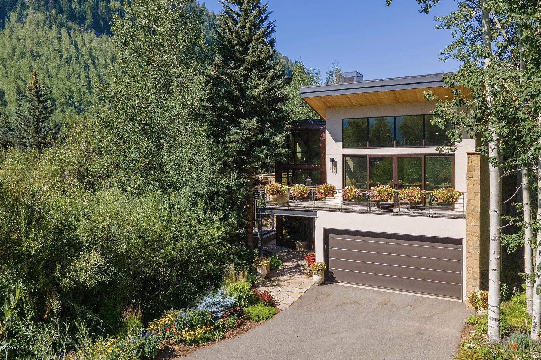 Mountain modern 5-bedroom home features soaring windows and picturesque views of the surrounding mountains, Designator ice wall/waterfall and aspens. Feels like a single-family home with the private driveway. All bedrooms boast ensuite bathrooms. Multiple decks to take in the beautiful surroundings. The architect was Kyle Webb and Nedbo Construction was the builder. For more photos and details visit: 2995BoothCreek.com/?mls.