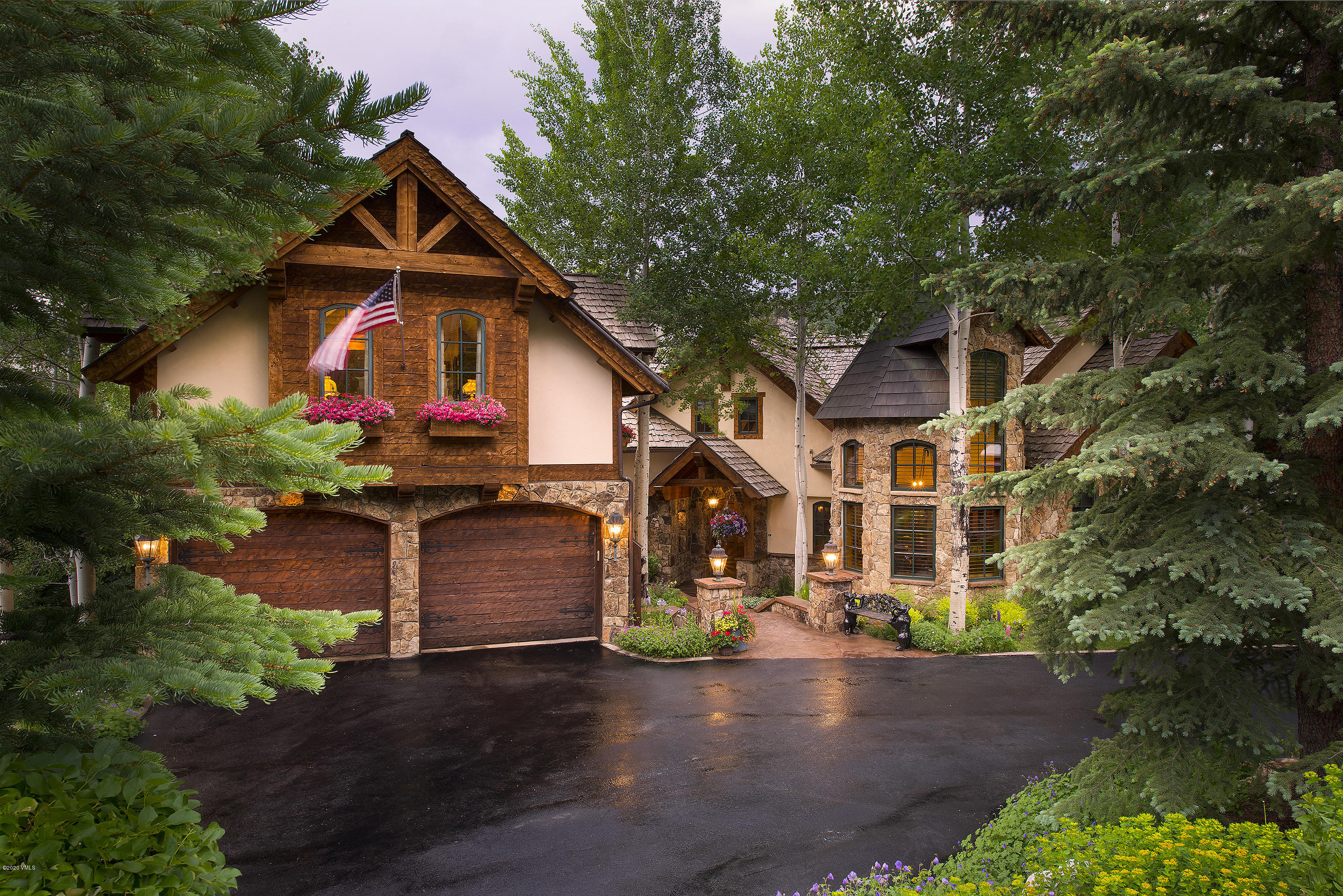 Stunning, custom-built chalet where no expense was spared either in the initial build or the ongoing maintenance of this home, truly maintained fastidiously by the current/original owners. Great room features butternut white walnut wood floors and ceilings with arched buttresses, Colorado moss stone, and expansive floor to ceiling windows framing the view of the ridgeline and mountain side across the way. Master bedroom is in its own private wing of the home with its own deck, large walk-in closet, and an oversized bathroom with jetted tub, steam shower, and towel warmers. Spacious dining room perfect for entertaining and attached kitchen fit for catering and cooking for the masses, with cozy adjoined breakfast nook. Custom millwork and cabinetry throughout. Lower level features a wine cellar, family room, access to outdoor spaces including a covered hot tub, fitness room with a sauna, and all secondary bedroom suites that feature en-suite bathrooms, large walk-in closets, fireplaces, and solid double doors to enter. Upper level bunk room is perfect for kids to gather and is separate from all other bedrooms. Additional loft area is a perfect location for remote office space. Interior and exterior are thoughtfully designed, and all high-quality finishes installed throughout. Sold exquisitely furnished and turn-key.