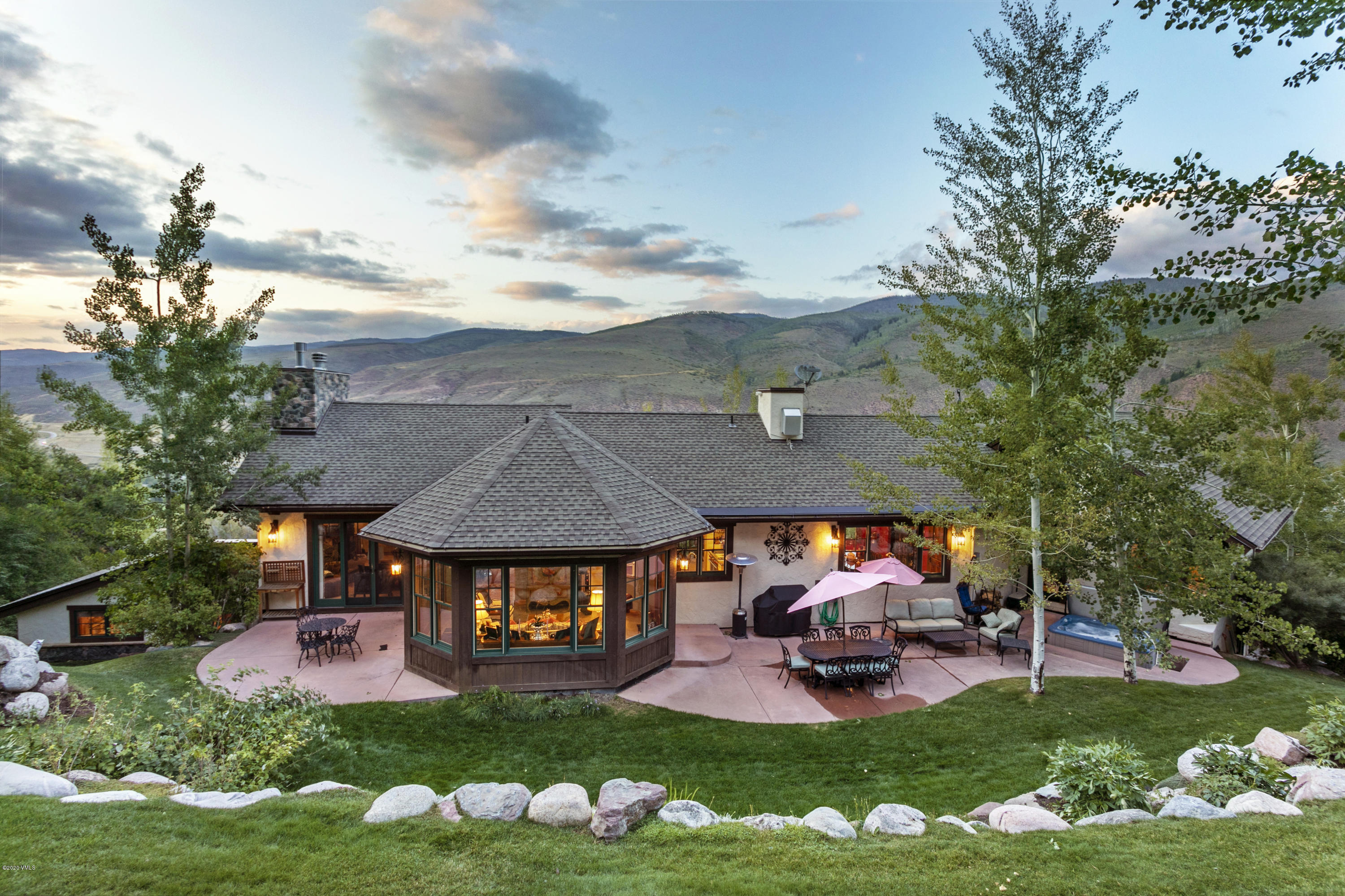 Rarely available, and offered for the first time, this custom-built single-family home at the top of Eagle-Vail is the epitome of luxurious mountain living. Elegance of design greets throughout this meticulously maintained home - from the hand-hewn knotty alder wood floors, Copper bar top, 6-inch Alder baseboard, to the beautifully landscaped outdoor areas. Extraordinary for entertaining, this home has a welcoming open concept main level, wet bar, home theater, elevator, and separate dining area. Relish in the warmth of the Grand room with high-vaulted ceilings, wood-burning fireplace with gas assist, and expansive views across Valley. A gourmet kitchen with Wolf French top range, pot filler, Sub-Zero refrigerator, two Asko dishwashers will make meals a pleasure-A local celebrity chef told owners that the kitchen is so well designed it is one of his top three favorite home kitchens ever. The Master bedroom suite offers tranquility away from the main areas of the home with stunning views. Enjoy sunset dinner on your walk-out deck, two walk-in closets, and a large master bathroom with soaking tub. Backing to National Forest and on a quiet road, the privacy of this home and abundance of nature and wildlife is second to none. An oversized 3-car garage, finished basement, and additional storage areas provide more than enough room for cars, toys, and all the gear your mountain lifestyle will desire. Unique to this home is a home office with two private offices, a common area with 3 workspaces, kitchen, and full bathroom - this could be a caretaker's suite or lock off. Snowmelt driveway, heated and lit front entrance steps, 700+ bottle wine cellar, drip and irrigation system, and brilliant sunsets - this is exceptional mountain living, all within 15 minutes of Vail Village and even less to Beaver Creek.