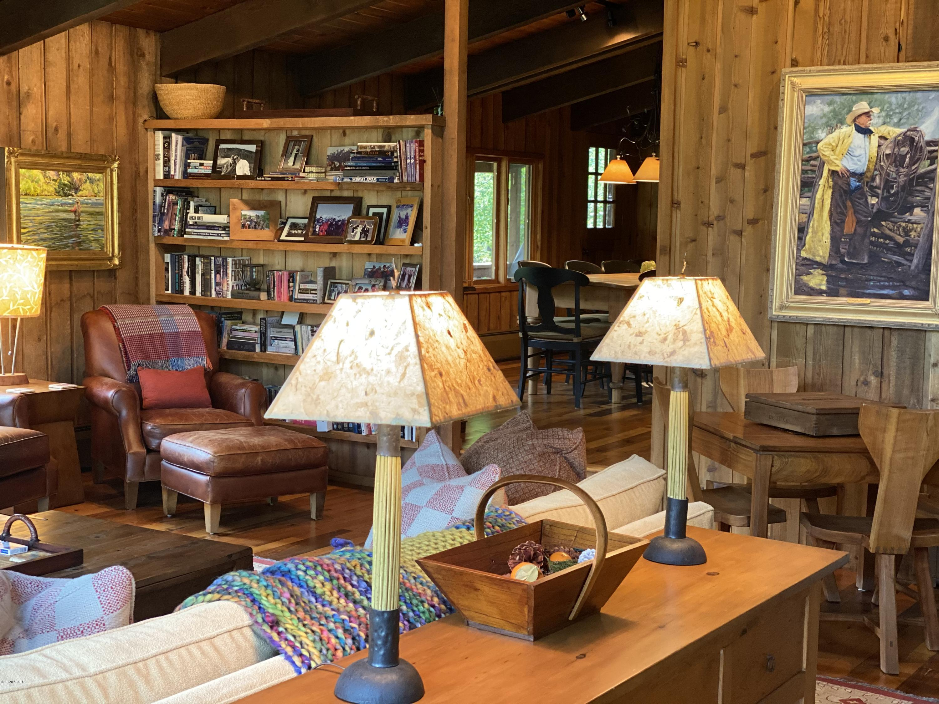 A Gore Creek fronting East Vail Home with a charming western feel with commanding western views towards Bald Mountain and surrounding forest land.