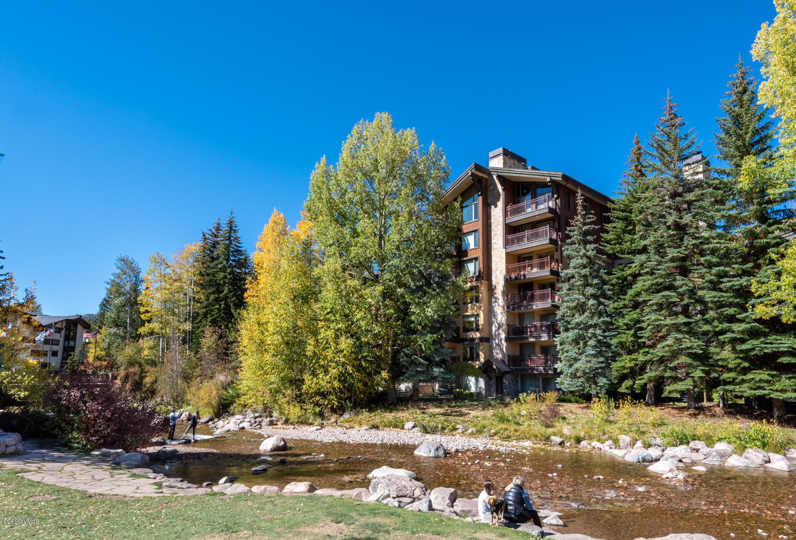 Vail Village luxury 3 Bedroom Condominium, where you can relax on 1 of 2 decks and take in the  spectacular Vail Mountain and Gore Creek views and listen to the peaceful sounds of water flowing by.  Entertaining is easy in the gourmet chef's kitchen open to the living room with gas stone fireplace and spacious dining area with custom storage and lighting.Wake up in the exceptionally large main bedroom with its own gas fireplace and large balcony overlooking the creek and mountains.  Relax after an active day of skiing in the steam shower and jacuzzi tub in the main bath. The custom closets, lighting, humidification, added storage, washer/dryer, beamed ceilings, custom Alder panelling, wide hardwood plank flooring, silk carpeting, silk window coverings define luxury.  Relax in the outdoor hot tub, heated pool, or warm up next to the fire pit after a day on the mountain.Look no further for the condo on the creek with amazing mountain views and 2 garage assigned spaces.  Manager on site.  Village Center, a very special condominium in the center of Vail to be your home in Vail.https://villagecenter5c.relahq.com/?mls