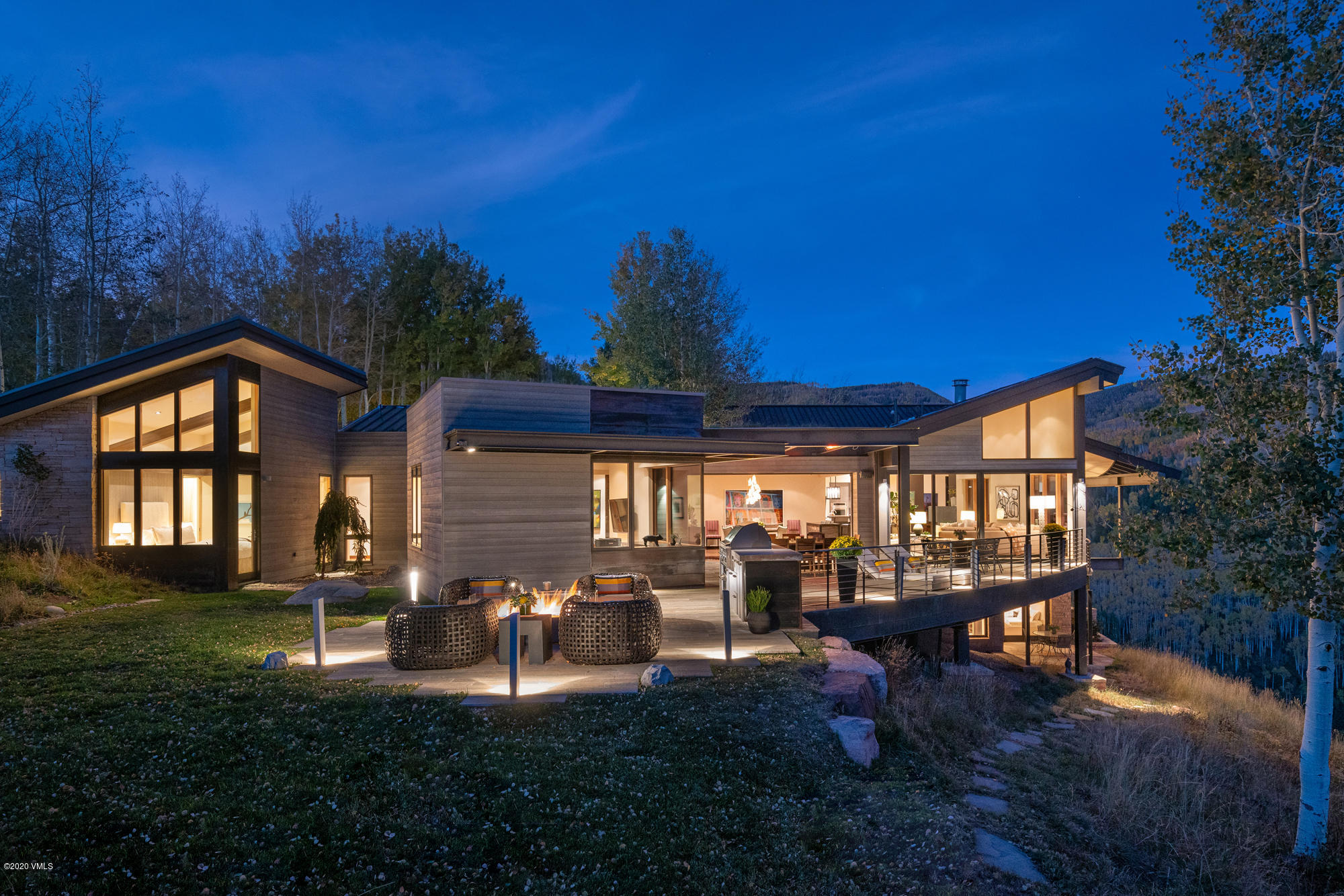 Tucked away in a dense forest of quaking aspen, high above Avon, Colorado in the exclusive Mountain Star neighborhood, 1268 Paintbrush will excite your senses with breathtaking views unlike any other in the Vail Valley. This six-bedroom, eight-bath, 8,590 square-foot residence is a mastery of classic modern design by KH Webb Architects with a complimentary mix of materials and an innovative layout that highlight its exceptional mountainside location. From any vantage point in this truly private residence, not a single residential or commercial structure obstructs the sensational scenery of the protected Buck Creek Gulch below and the White River National Forest to the east. It's the kind of ultimate privacy that is talked about yet rarely found. When contemplating this modern masterpiece, it's hard imagine a more special location in the Vail Valley that's also just six minutes from the bustling Town of Avon and Beaver Creek Resort, and 20 minutes to Vail with world-class recreation, shopping, dining and resort amenities. Please visit MountainStarViews.com/?mls for more details.