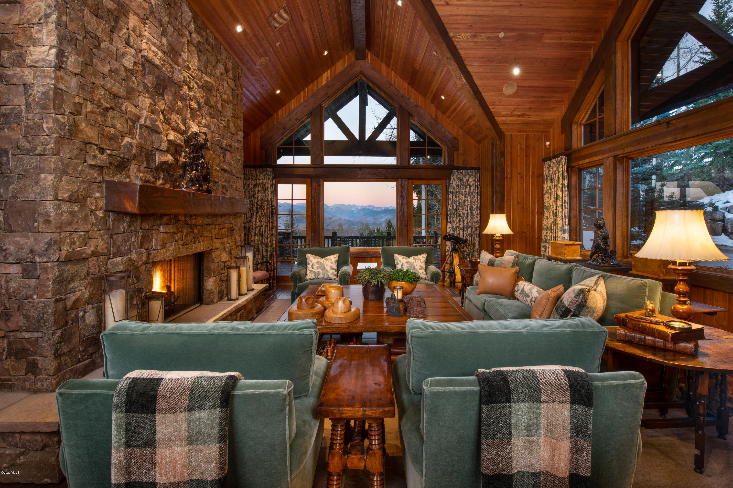 Very first opportunity to own Moose Head Lodge, one of Bachelor Gulch's most exquisite custom-built homes. Great room offers high vaulted ceilings with custom wood throughout, a grand stone fireplace as the focal point of the room with direct and unobstructed, expansive and picturesque views of the Gore Range to the east. Well-appointed kitchen complete with its own wood-burning pizza oven wonderful for family get-togethers. Home is built on a large homesite with mature trees that provide for privacy in a secluded on-mountain setting. Perfect ski-in/ski-out access via Solitaire Ski-way right to the back door and heated back patio. Located directly off the patio is an over-sized ski room with cubbies for all residents and an adjoining hearth room ideal for your very own private apres-ski hour. Attractive and comfortable main-level primary suite with his and hers closets and expansive bathroom with steam shower, jetted bathtub, and direct access to the outdoors and hot tub area. Private and pretty over-sized upper-level junior suite and secondary bedroom, both with en-suite bathrooms. Lower level features 3 additional bedrooms; theater room with brand new 4k projector and surround sound; wine room and ample storage. Many recent upgrades enhance the property such as a new: DaVinci roof, hot tub, water heater, Control4 central control lighting system and water shutoff sensor system. Ample surface parking provided with a 3-car garage and additional overflow spaces in the heated driveway. Sold designer furnished.