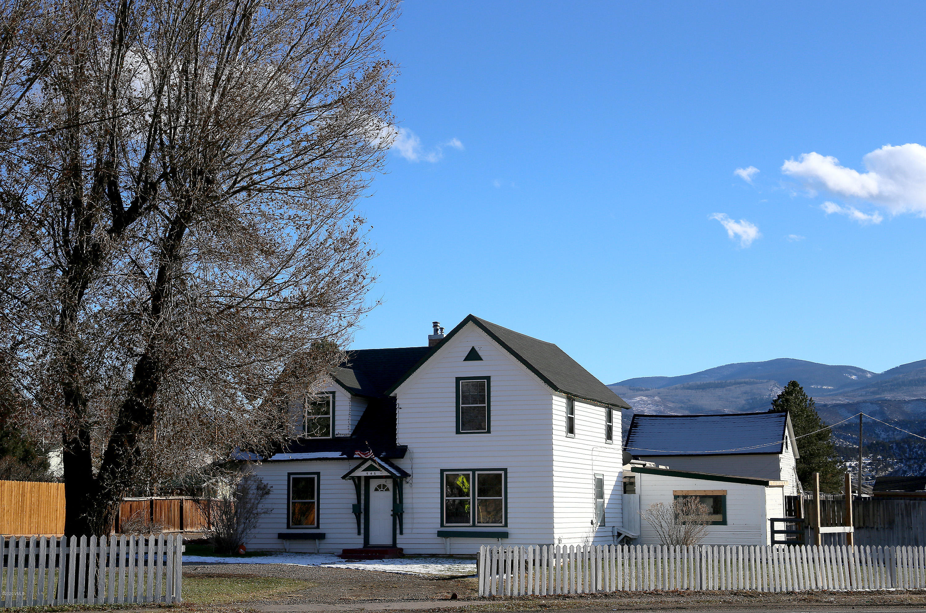 Truly a unique opportunity to develop in a premiere location with 2 access points off of Highway 6 and another separate access off of 6th Street. This land was originally owned by the Bucholtz Family and their 1908 Sears & Roebuck residence has been well-maintained with 4 bedrooms and 1.5 bathrooms. This is one of the largest parcels in old town Eagle undeveloped with water rights and 2 acres to be improved with commercial, residential or subdivided. Next to the property's west entrance is a flashing light crosswalk leading to the Eagle River path and direct access to the Eagle River Park or Eagle County Fairgrounds. The Town of Eagle is currently in the process of developing a Highway 6 Corridor Plan which will assess traffic patterns on Highway 6, with a specific focus on the Downtown Core and West Eagle where this property is located. Great exposure to all people traveling to and from the Eagle County Regional Airport. Sale will include the house and 2 story barn but excludes all personal property and other outbuildings including greenhouses.