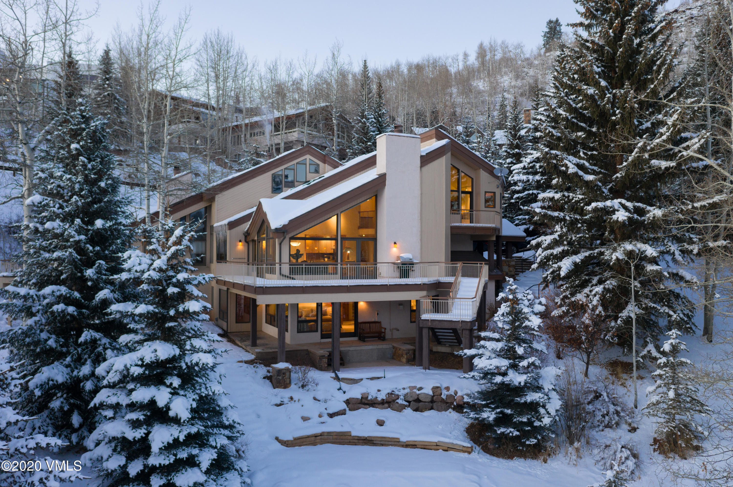 You don't see a home with ski slope views like this everyday! Welcoming walls of windows lead out to an over-sized deck and a first hand look at the snow report for Vail.  In the summer you will be able to relax in the mature, fully landscaped perennial garden that includes a spring fed water feature.  This is a quintessential Vail home in the exclusive Potato Patch neighborhood.  The home was completely remodeled (down to the studs) in 2005 with many thoughtful upgrades and an expansion to the floorplan.  Plenty of room for a large family with 3 bedrooms and 2 large dens that can be used as additional sleeping spaces or offices.  Bright and sunny on all levels with a master bathroom and closet to die for.  This home and views have to be seen to be believed.  Offered mostly furnished.