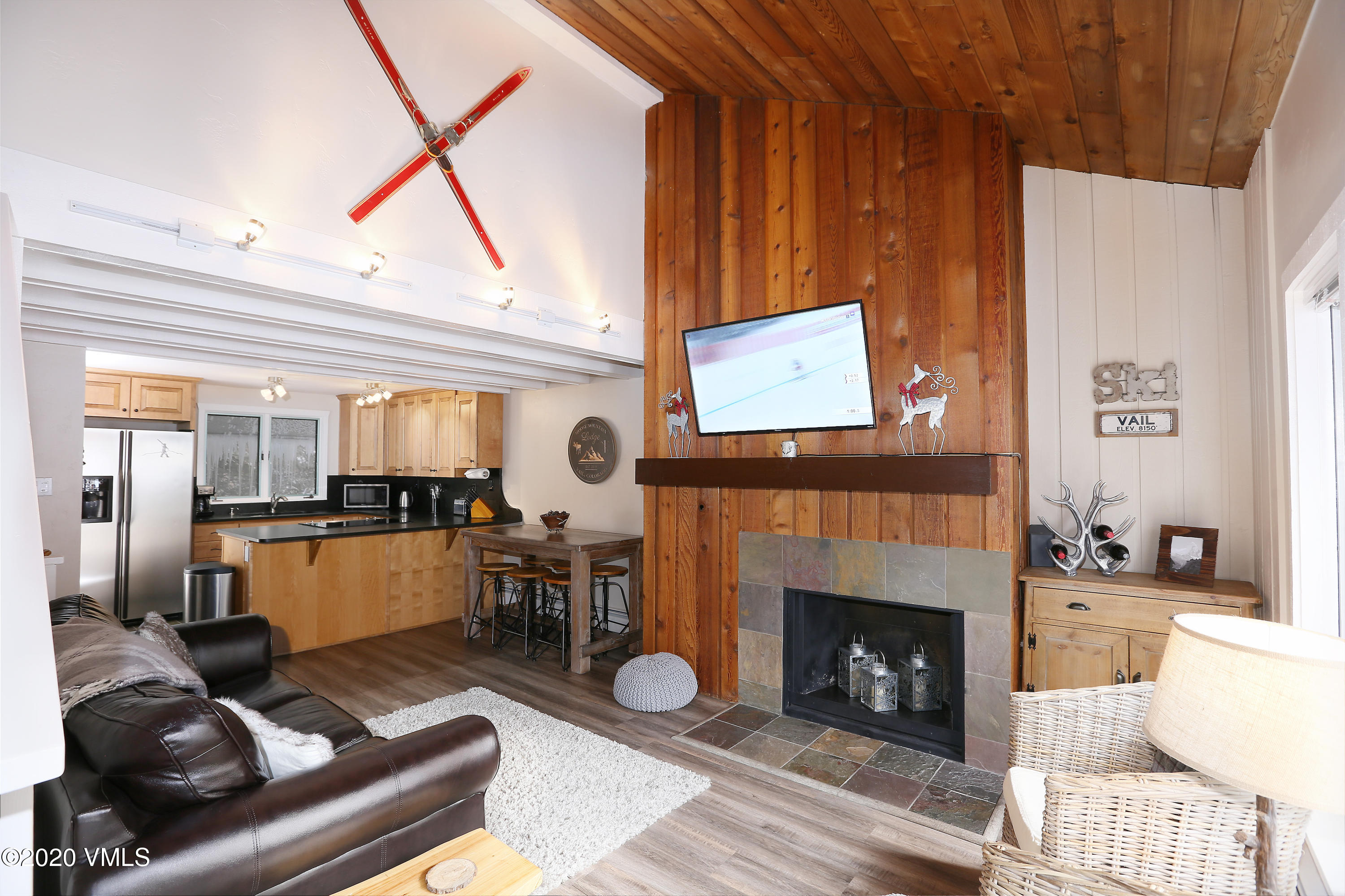 Elegantly renovated spaces in this 2-bedroom mountain retreat with 3rd sleeping area for your guests. The beautiful setting in West Vail has a large south facing deck plus it is right on the Vail bus route and only minutes from Cascade, Lionshead and Vail Villages for skiing, shopping and dining. Take easy walks to fish on Gore Creek, hike the many trails nearby, or enjoy the great park only steps away. Inside you can enjoy the cathedral ceilings, new flooring throughout, new paint, granite kitchen counters, maple kitchen cabinets, and heated floors in the entryway and kitchen. Low HOA dues with heat included and 2 parking spaces make it perfect for a vacation home, primary residence, or long/short term rental.