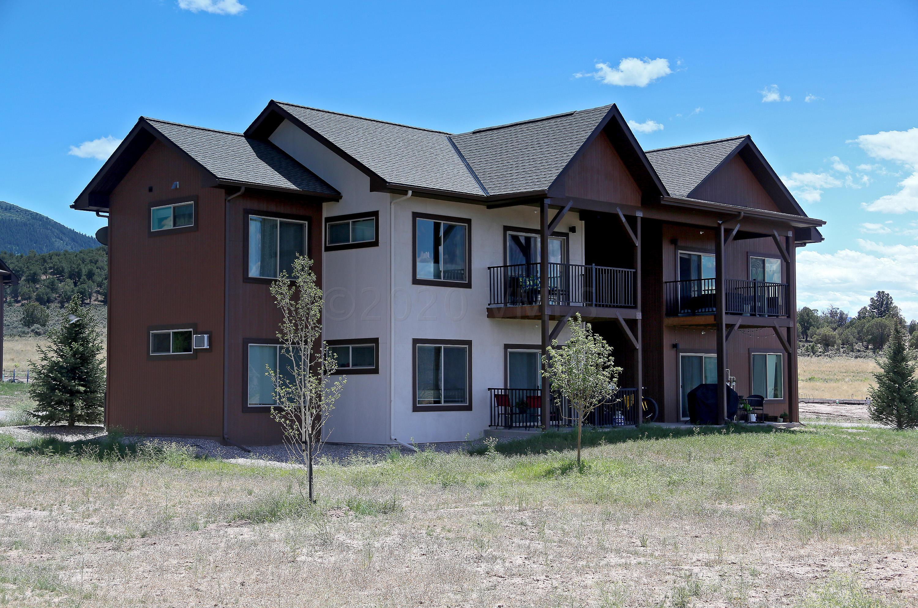 New ground plan with 2-bedrooms/2 bath. Quality-constructed condominium with quartz countertops, tiled showers, stainless-steel appliances and private storage. Ownership also includes 100% access to thousands of acres of open space year-round right out your front door. Photos are of another finished unit (E101). Come discover Upper Buckhorn Valley.
