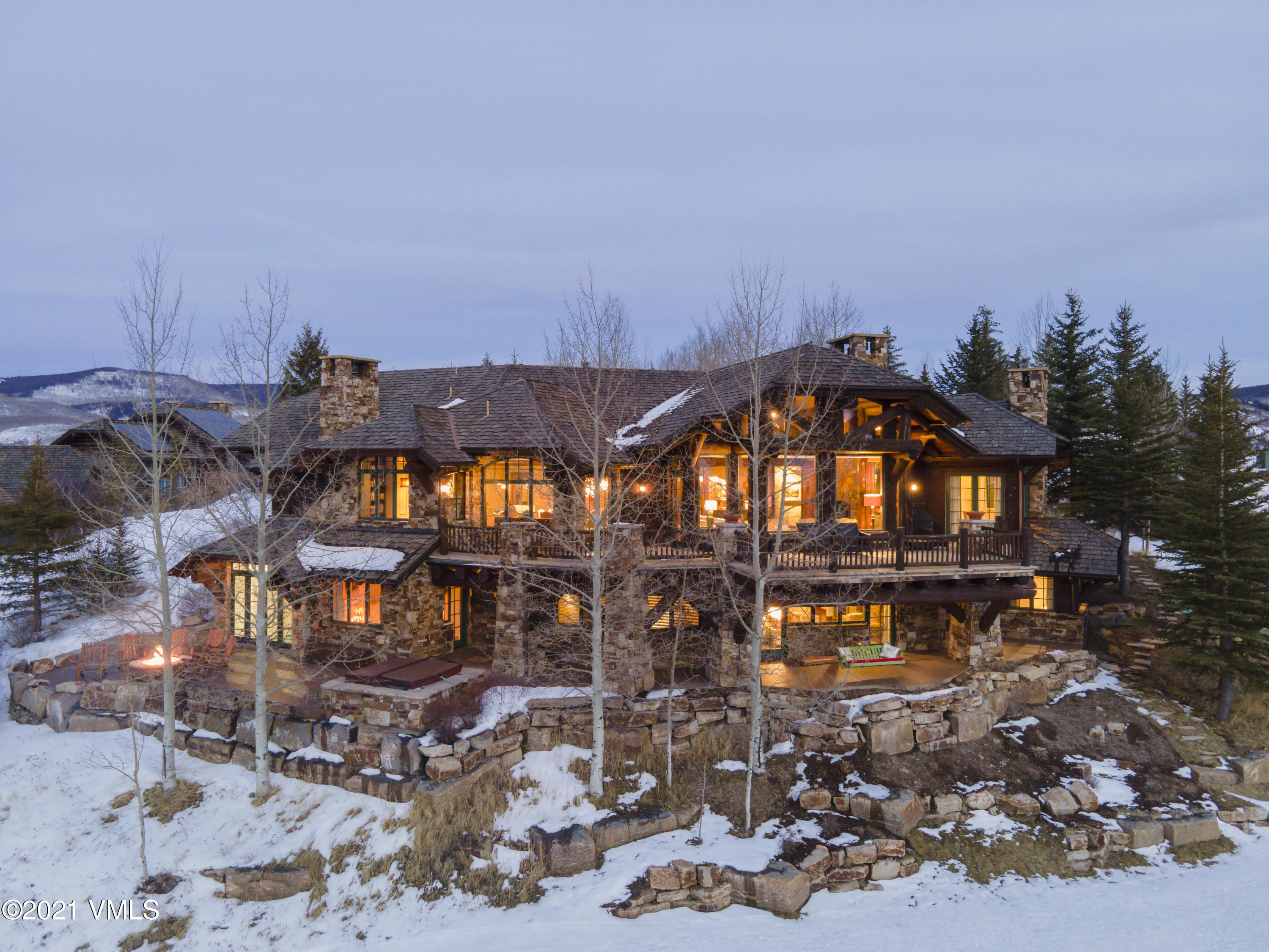 This home is a beautiful marriage of a Bachelor Gulch log home and mountain transitional decor; an extensive custom remodel has been completed since the home was originally built.  The main level offers a highly desired floor plan, with a master bedroom, a spacious open living room which flows easily into the kitchen and dining room. Elevator access takes you to the generous family room, and 3 additional customized guest bedrooms. Home sleeps up to 18.One of very few homes in Bachelor Gulch to offer an indoor swimming pool, a steam room, sauna and workout studio. Tucked away on the upper level is a charming guest suite, nursery and play loft for children or grandchildren. Recently expanded outdoor balconies and patios are a magnificent place for family gatherings and spectacularoutdoor living.Sensational 270-degree sunset views capture your attention from the moment you enter this warm and inviting home. Watching the active landscape of skiers during the daylight hours and the lights of the Bachelor Gulch Village during the evening hours is very reminiscent of the quaint ski villages in Europe.  'Leave the Beav' ski-way is directly accessible from your private ski room to the lower Beaver Creek ski lift and allows quick access to either the upper Bachelor Gulch or the lower Bachelor Gulch Village ski lift's, the ski-in has a short easy walk home.