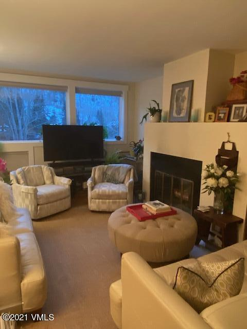Sunny, bright condo with southwestern  views to mountains.  In 2018, all new Pella windows, patio door, new wood window casings, new Hunter Douglas blinds, all new Kitchen Aid appliances, Zephyr hood; new sink, faucet and garbage disposal.  Condo has hardwood floors, granite counters.  Cherry kitchen cabinets, wood burning fireplace, washer, dryer.  Newer hot water heater.  Deck.  Building has fire alarm system.  On TOV bus route.  Pitkin Creek has a year round hot tub, a summer pool, volley ball court, park like setting.  Well run HOA.  Easy access to recreational trail, hiking trails and bike path.  Walk along Gore Creek to the Vail Golf Course, or ride your bike into the Village or up and over Vail Pass.$500 carpet allowance at closing.  Professional photos coming soon. Condo may be eligible for Vail In Deed Program.  Owner/Broker.