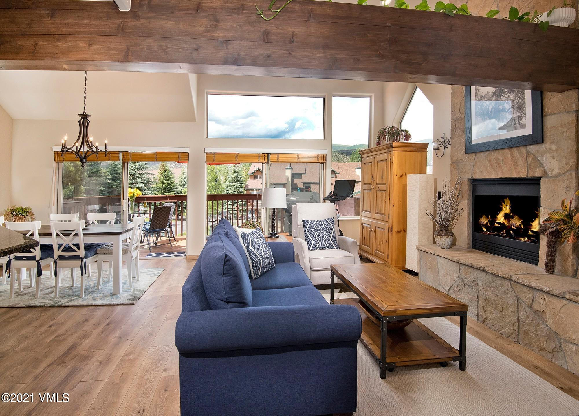 End residence backing up to open space with tons of natural light, large decks and vaulted ceilings.  Each bedroom has its own full bath including the fully equipped mother in law suite. Two car garage plus covered parking for two. Community clubhouse, pool and hot tub. Blocks  to schools and all that Riverwalk has to offer. Hurry, this one won't last!