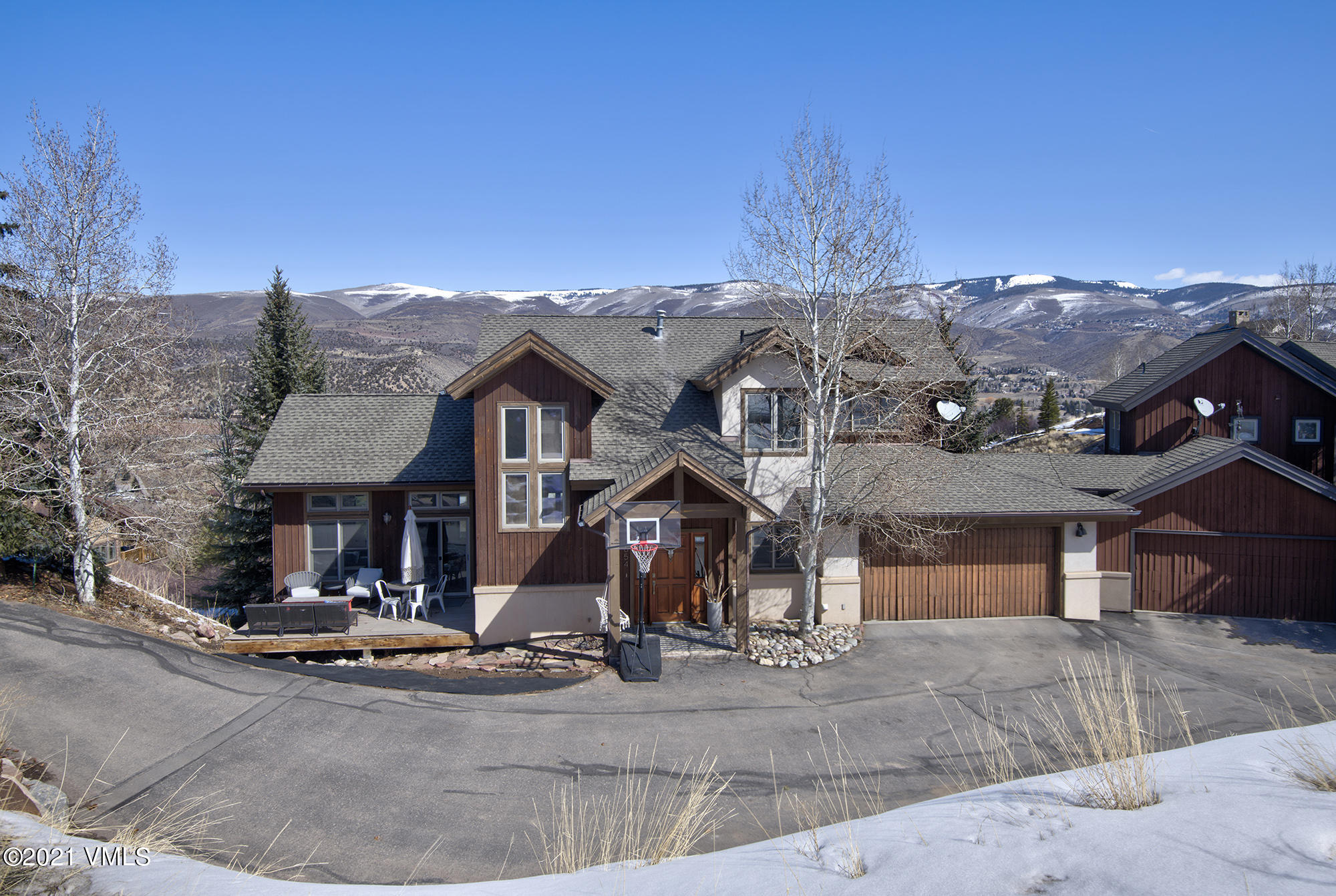 Relax and enjoy the elegance of this beautifully updated 3 story home. Sitting in upper Homestead provides amazing view that overlook all of Edwards from its three decks and large lot. Entertaining is easy with the open floor plan and spacious area. Features include master bedroom and bath on the top floor, updated kitchen countertops & cabinets, dining area and family room plus a patio deck all on the main floor. Mudroom and washer/dryer room also on main floor after entering from the 2 car garage. Finished walk-out basement features a kids bunkbed room with a Jack & Jill full bathroom that connects to the guest bedroom. Guest bedroom has its own private deck with seating area and amazing views. Down the hall there is a steam shower full bathroom, and also a large bonus room used currently as an entertainment room.