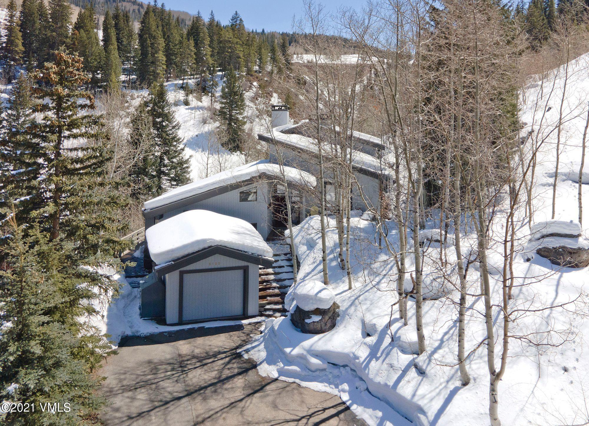 Charming and lovingly cared for home in East Vail. Many upgrades to this property have been added/done in recent years. Kitchen area has 2 side x side Refrigerator/freezers and there are 2 washer and dryer sets.Very private with wonderful views! Over 9000 s/f can be built on this .95 acre lot.