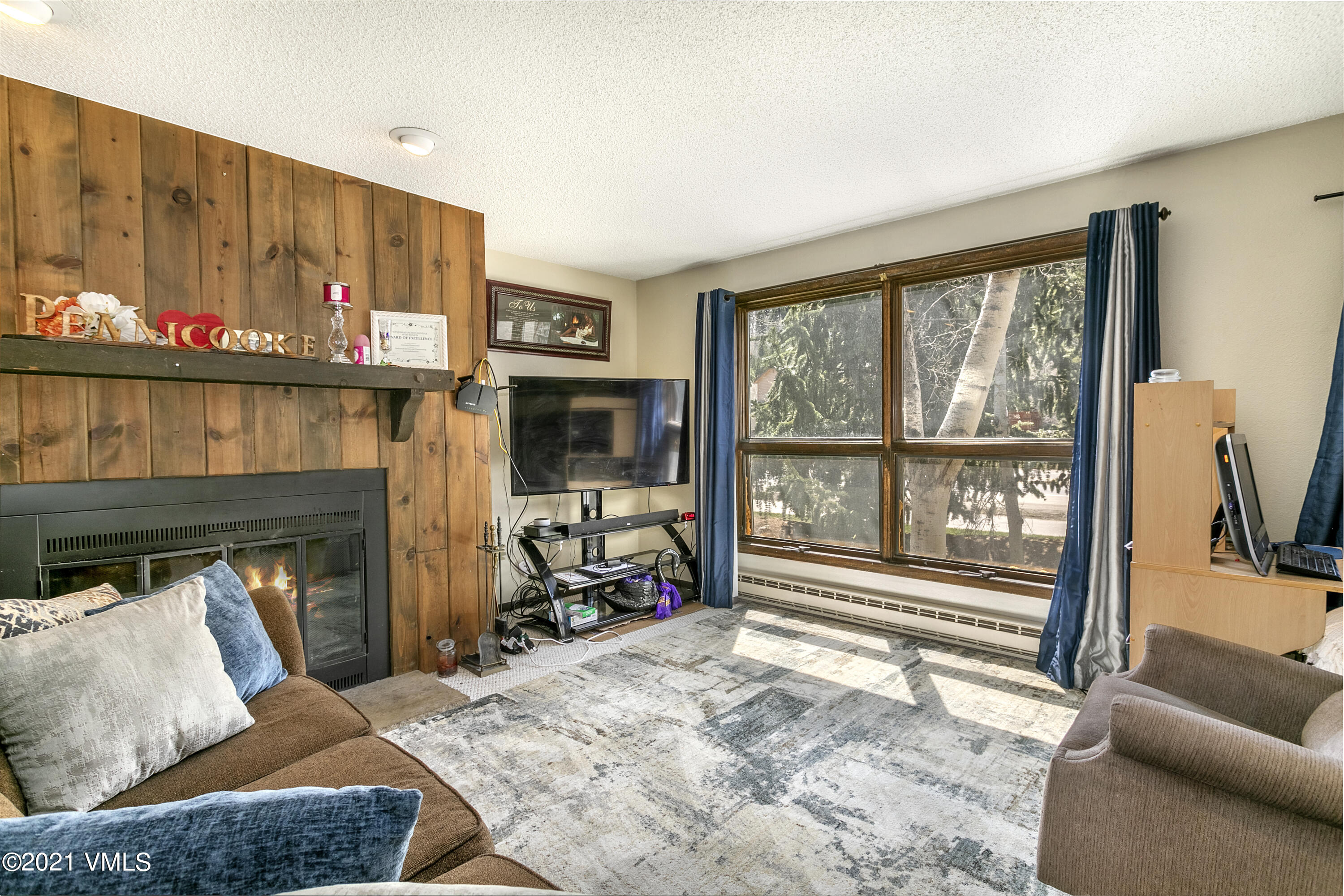 This meticulously clean second floor condo has two bedrooms and  2 full baths all on one level.   After the current tenants move out 10/31/21, the new owner will be ready to start the winter enjoying the wood burning fireplace and deck surrounded by trees.  There are several storage closets and unassigned surface parking.   With a well-managed HOA, this condo offers a great opportunity to get into the Vail real estate market at a reasonable price.
