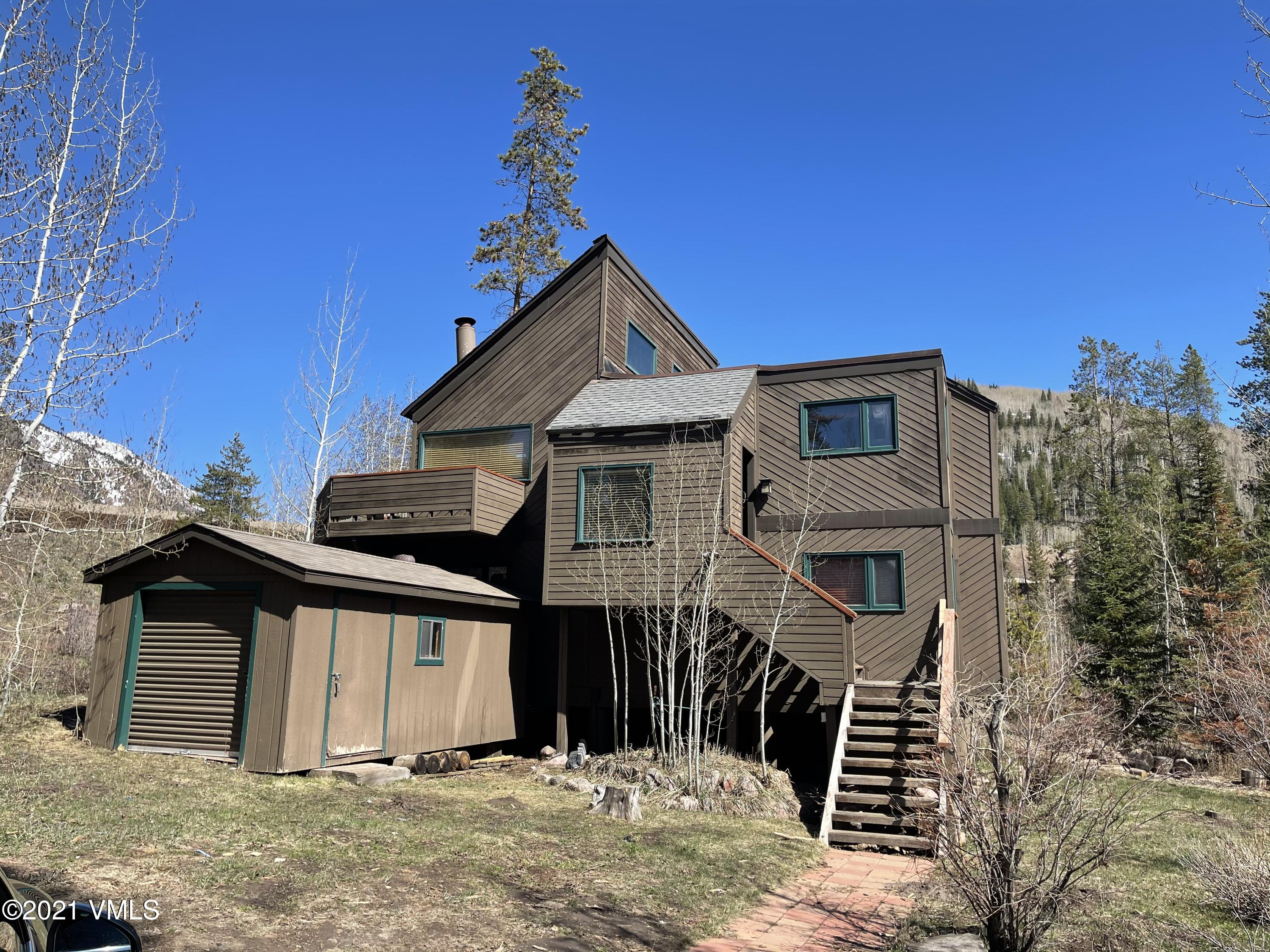 Rare find in East Vail.  This home is situated across the street from the Bighorn Trailhead, offers waterfall views, steps from bus route all in a quiet neighborhood. Existing home makes great 2nd home or rental.  Dream home plans are available that have been approved by the Town of Vail. Can be permit ready.  Interested parties may request plans for new custom home with pool.  Also new custom home makes great 2nd home and/or rental.