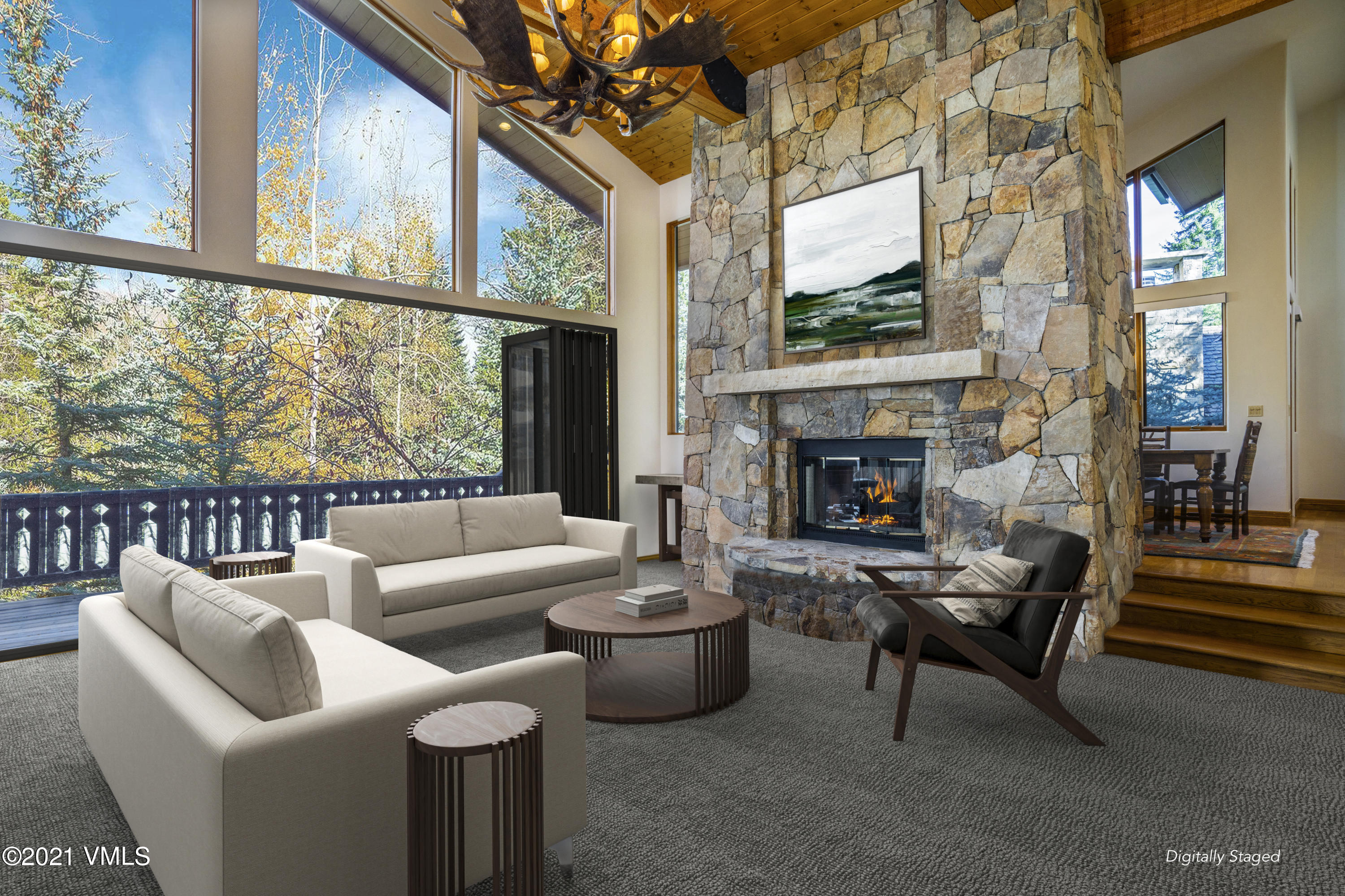 Conveniently nestled at the intersection of the prestigious Forest and Rockledge Roads in Vail Village, this home enjoys a special location on Vail's renowned mountain - close to skiing and Village activities, yet tucked away in the forest for quiet and privacy.  A beautiful mountain chalet, the home is perfectly proportioned for family, friends and guests. Its main level includes towering vaulted ceilings creating vertical volume, and walls of windows on the east and north beckoning in mountain sunlight through the surrounding pines. A stunning stone chimney between the living room and dining room defines the two spaces while its double-sided fireplace provides warmth to and ambiance for both. The spacious living room has separate areas for lounging and playing games, includes a wet bar and opens to a cozy den for reading or tv watching that is adjacent to that now coveted dedicated office space. This large main level living room has a wall of glass doors that open to an expansive wrap-around deck big enough for multiple sitting areas enabling a variety of indoor/outdoor living and entertaining options. The straightforward kitchen boasts bountiful cabinet space, double wall ovens, 5-burner gas cooktop and another wall of windows for light and bright cooking. Separate from the guest rooms, the spacious upper level master suite includes two bathrooms, its own walk-out deck and a picturesque Juliette balcony. The home's lower level features a walk-out family room with fireplace and three additional bedrooms each with their own direct access to another large deck complete with hot tub and big enough for a hammock...perfect for lounging after a day on the slopes or mountain bike.  Features of this home include heated stone driveway, epoxy floors in the 2-car garage, expansive deck space on both levels, large bedrooms each with walk-out access to a deck, high ceilings and windows galore creating light and bright spaces throughout the home.