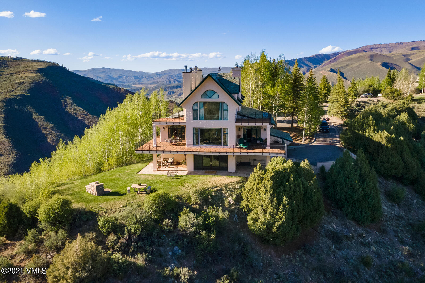 Curious about what makes Cordillera so incredibly wonderful? Come and live like a local in this luxury gated community. Find out for yourself by becoming the new owner of 115 Alhambra Place in the convenient Divide of Cordillera. A sweeping 90 foot deck invites entertaining on a grand scale as guests jaws drop in disbelief from the panoramic scene of the Gore Range and Back Bowls of Vail to the east, south to the Sawatch mountain peaks and west to the Ranch and Summit communities of Cordillera. Retire to your master suite on its own level with 2 generous sun decks, his and her walk in wardrobes and a soothing spa-like bathroom while observing majestic views in all directions in undisturbed privacy. This iconic residence sits on over 10 acres of land and offers 3 additional bedroom suites all with ensuite baths. Blow your guests away as they are greeted by 2 large coppered lions flanking an 800 year old wooden door at the grand front entrance. Once inside, friends and family will be instantly drawn into the great room with exposed wood beams and European charm toward the copious windows and French doors leading to the generous outdoor living areas. From the lower level living space, open the enormous sliding glass doors for a seamless transition to a flat enjoyable back yard and take in the warmth of an outdoor stone fireplace. Superior new upgrades throughout the residence. 115 Alhambra is awaiting you. What are you waiting for? Schedule your private showing today.