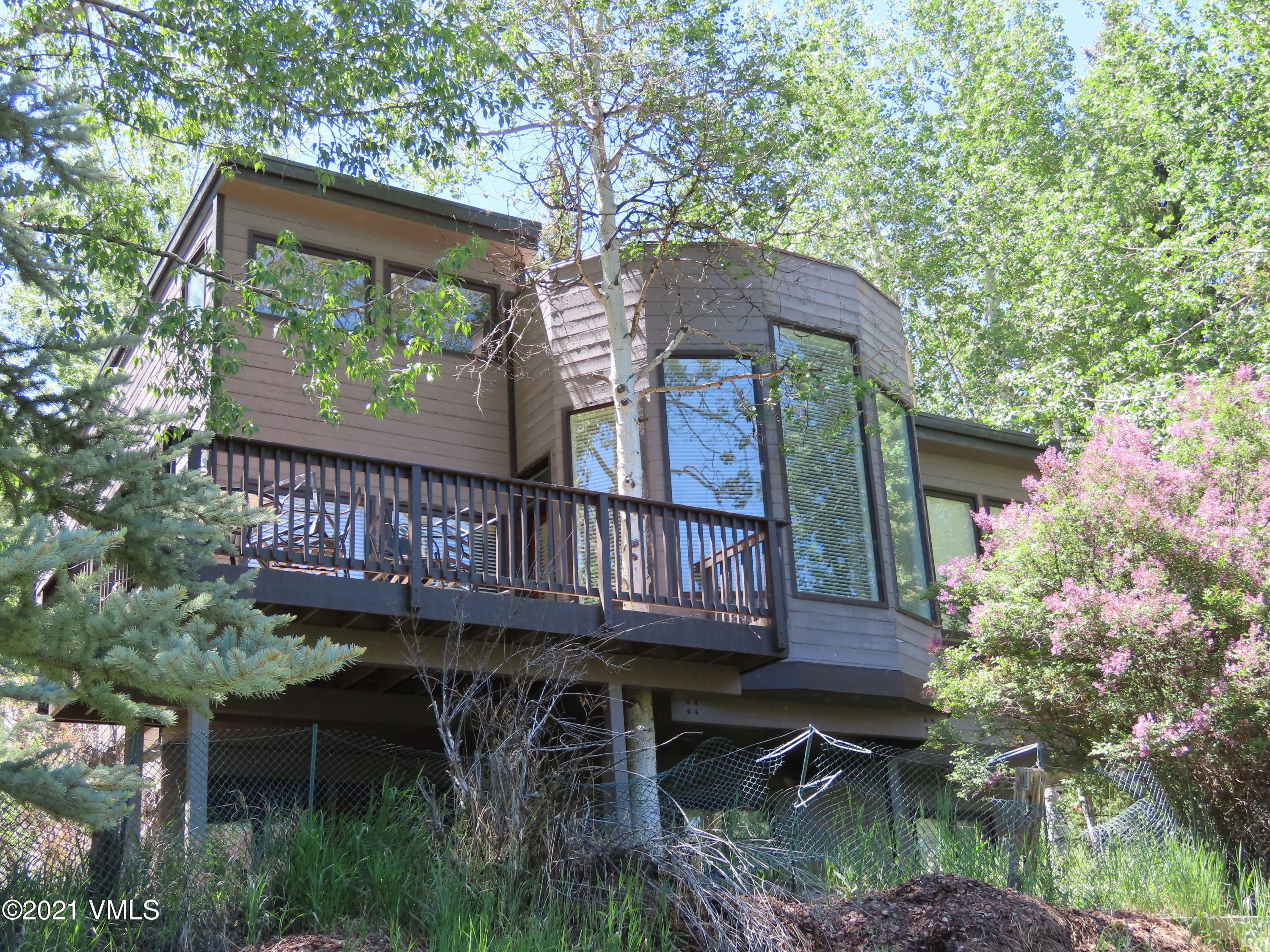 Single-family home in need of a remodel.  Great West Vail location with Gore Range views!