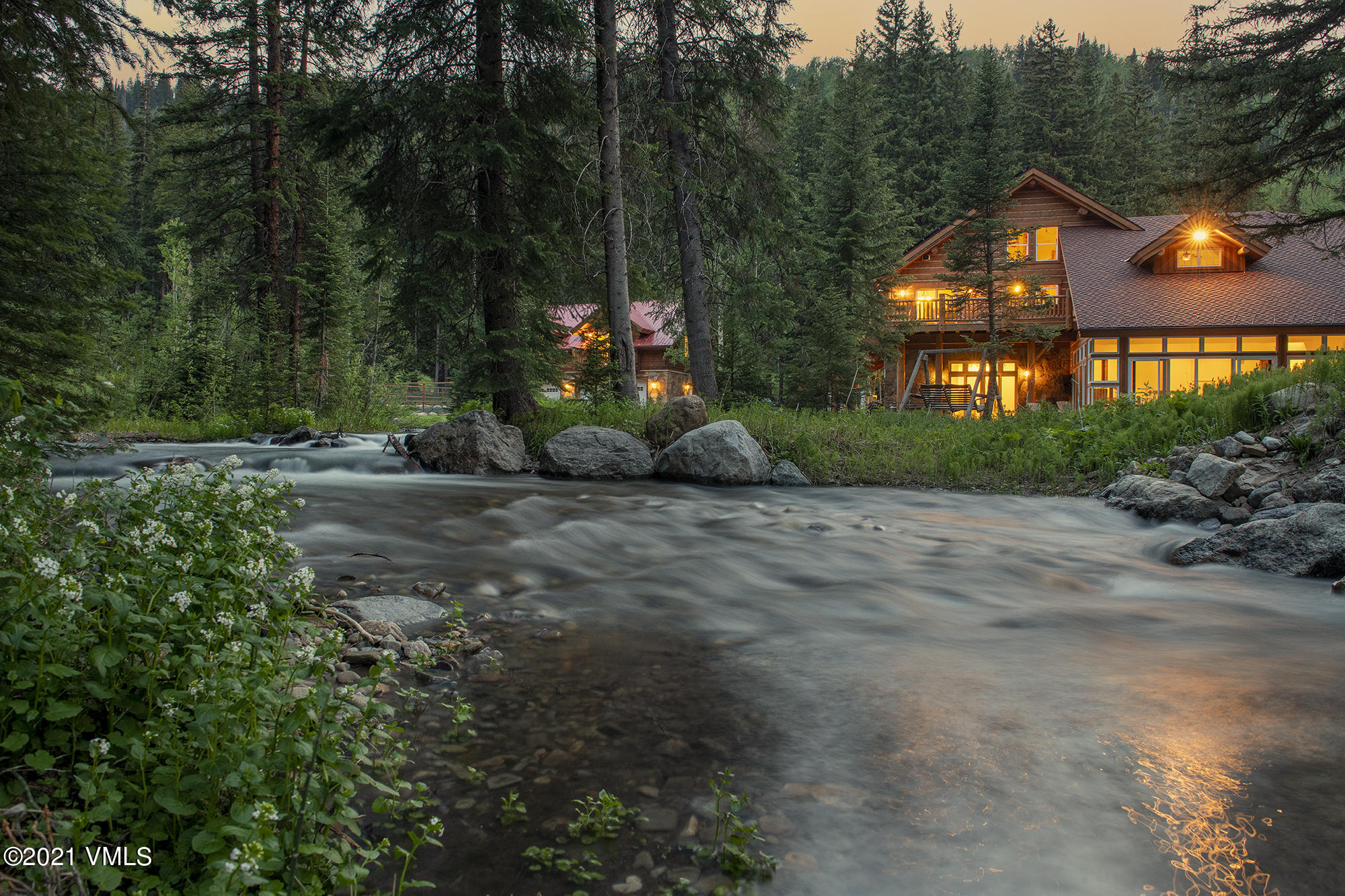 If a custom built creekside home with absolute privacy, acreage, convenience, water-rights, views and direct National Forest access has been a dream, then this property is that reality. This legacy estate is minutes from Vail and Beaver Creek and offers your own personal Colorado mountain playground. Hike, ski, snowshoe, ride horses or snowmobile on a trail system already in place. If 40 acres isn't enough, then being bordered by National Forest with over 100,000 immediately accessible acres will quench your adventurous thirst. The main home was finished in 2010 and features impeccable craftsmanship, finishes and creekside views where one can relax in absolute peace and privacy knowing you never need to lower your window shades. A separate guest building with additional 4-car garage, apartment and studio provide overflow for guests, caretakers and mountain toys. Grow your own vegetables in the fenced-in and mature garden, ride horses in the riding arena with tack barn and store additional mountain toys or machinery in the overflow out-buildings. All the hard work creating this estate is complete and ready for your immediate enjoyment. The connected neighboring parcel to the south, 801 Holy Cross Drive, is also for sale, creating a once in a lifetime opportunity to control 120 acres of pristine and private creekside land. This parcel is also bordered by National Forest and is zoned resource, with no HOA or Design Review Board, allowing for a multitude of design and building opportunities. http://www.HolyCrossRanch.com/?mls