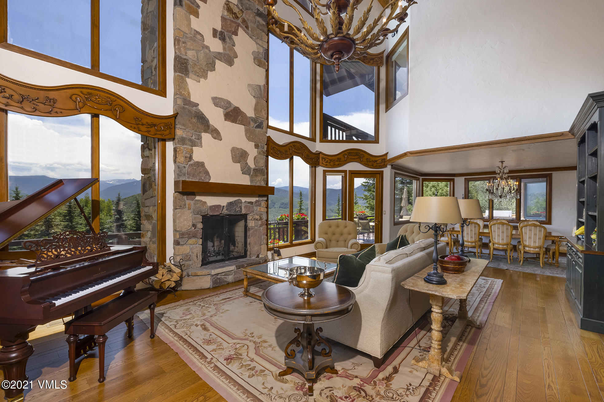 Opportunity to own this iconic home atop The Divide at Cordillera. Custom-built for the original developer of Cordillera, Felix Posen, and then owned by Kathie Lee Gifford. Original home can be seen featured in the Kathie Lee 'Home for Christmas' special. Homesite was hand-picked by Mr. Posen for its magnificent 360-degree views of the Gore Range, Sawatch Range, Flattop Mountain as well as New York Mountain. This thoughtful and comfortable floorplan provides en-suite bathrooms for each bedroom, decks off each of the six main level bedrooms, spacious upgraded country kitchen, extra lofted space, and stunning views from all rooms. Entry-level is home to two primary suites. The east primary suite is a corner room with big views, fireplace, private deck, high vaulted ceilings, his/her bathrooms, and closets, and sitting area or office. Additional primary suite is a corner room located on the west end of the home with gorgeous views, wrap-around deck, walk-in closet and bathroom, and sauna access. Large welcoming great room frames the picturesque views of the surrounding mountain ranges and features high vaulted ceilings, a wood-burning fireplace, and adjoined formal dining room creating a perfect space for warm and memorable gatherings. Additional entertaining spaces include a saloon-style bar area with fireplace; oversized family room; den and billiards room, all of which provide for easy access to the outdoors. Expansive deck and patio along the southern side of the home with outdoor hot tub, large pool, and fireplace to enjoy great Colorado days and evenings. Recently installed new tile roof. Extensive landscaping surrounds this special property with large acreage; 3-car garage. Perfect for one looking to enjoy a more traditional home with cozy comforts and a mountain chalet atmosphere. Private gated community with security and many amenities plus availability to join one of the best golf clubs that the Vail Valley has to offer. Timeless home sold furnished.