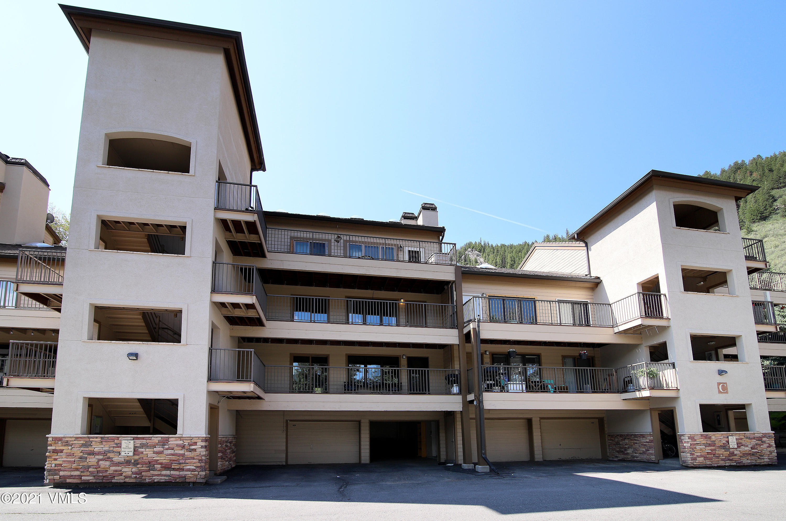 Newly painted 2-bedroom condo at the west end of EagleVail with large 2-car tandem garage with 2 extra storage closets. Room for all of your toys! Nice open floor plan with wood burning fireplace. Each bedroom has a walk-in closet. Huge outdoor deck with a second smaller deck off of the primary bedroom.  Brand new water heater. Great location close to the Beaver Creek entrance and to Avon, near the bus line and backing up to National Forest Service land. You will love all of EagleVail's amenities including the golf course, pool, tennis courts, pocket parks and community gardens. Skier shuttle available in the winter.