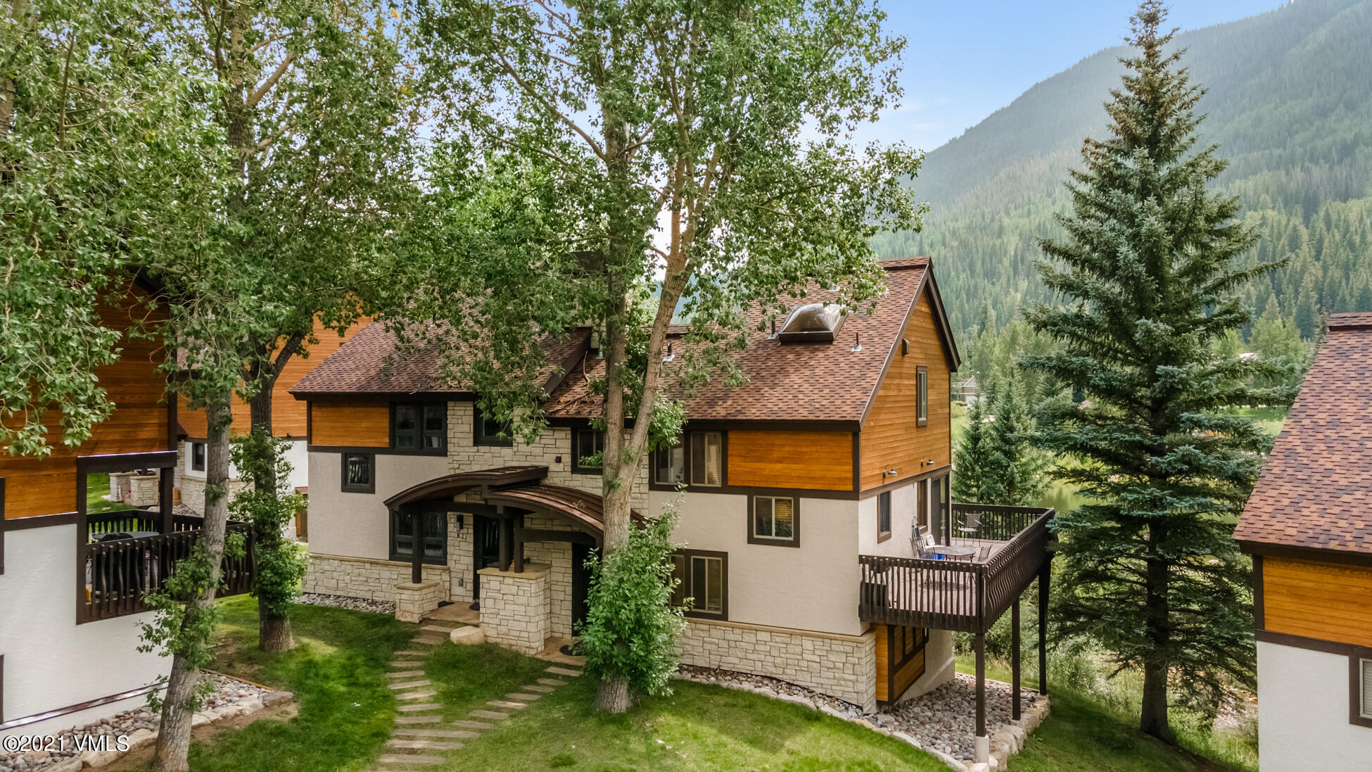 This 3-bedroom townhome enjoys an absolutely stunning location on Gore Creek offering unobstructed, sunny, southern views overlooking Bighorn Lake and Park. This unique, 5 half-level townhome is situated just steps from the Town of Vail free bus, making it convenient to access both Vail and Lionshead. You can drop your gear in the entry area after a day enjoying all that Vail has to offer before you head up to the main level where the living area offers vaulted ceilings with a skylight for natural sunlight, a wood burning fireplace, dining area, kitchen and a large deck. The beautifully renovated kitchen has tile flooring, cherry wood cabinets, granite countertops and stainless-steel appliances. The deck that sits off the dining area has new Trex decking and provides you with ONE-OF-A-KIND views. It is the perfect place to relax and enjoy your morning coffee and/or evening cocktails and barbeque while appreciating the beautiful East Vail setting. A laundry room is located on the 3rd half-level; while the master bedroom with vaulted ceilings and an ensuite bathroom with a jacuzzi tub and steam shower are located on the top level. A few steps down from the entry area are 2 additional bedrooms, each with ensuite baths, providing plenty of privacy for your family and guests. The lowest level offers a large owners storage closet as well as a crawlspace for all your mountain gear. The Vail Racquet Club is conveniently located near Bighorn Park, which sits alongside Gore Creek making it an ideal setting for families and pets to enjoy the surrounding mountains. As well, the Vail Racquet Club offers a year-round outdoor swimming pool, 2 hot tubs, health club/fitness center, yoga/Pilates rooms, tennis/pickleball courts, on-site restaurant/bar, sports shop and front desk. East Vail lends itself to a wonderful mountain atmosphere with easy walking, hiking and biking trails. Vail Village and Lionshead are a quick drive or bike ride as well as being easily accessed via the bus.