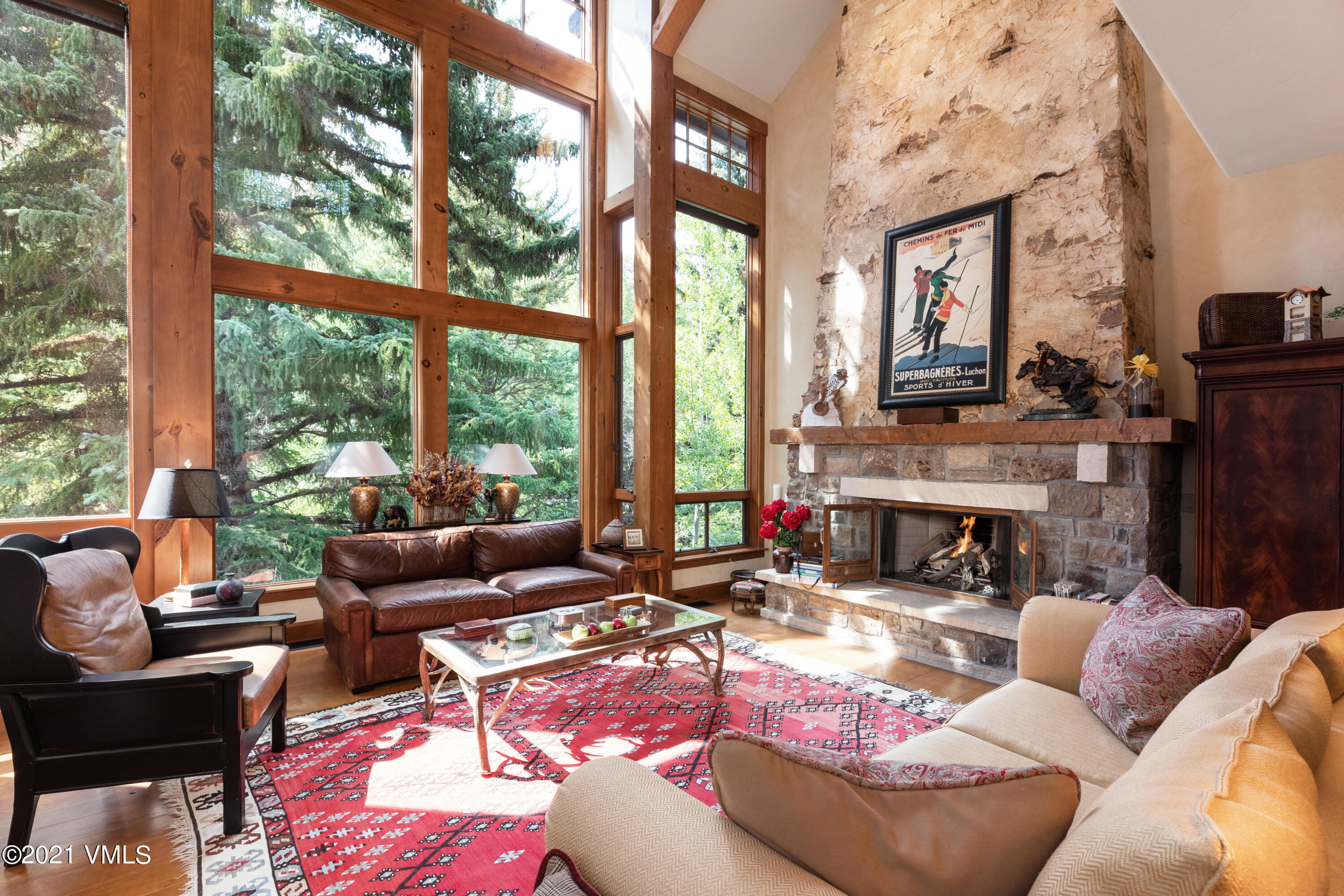 Enjoy the sounds of the creek and peaceful outdoor living from the serene deck setting off the back. This is a rare single family home located in the ski-in / ski-out Cresta neighborhood within the gates of Arrowhead. Featuring a master on the main level, a family room off the kitchen, stunning views from the huge living room windows, a lofted office and a recreational room down below. Offering both private fishing rights and ski access from the home, this is a perfect year-round retreat.