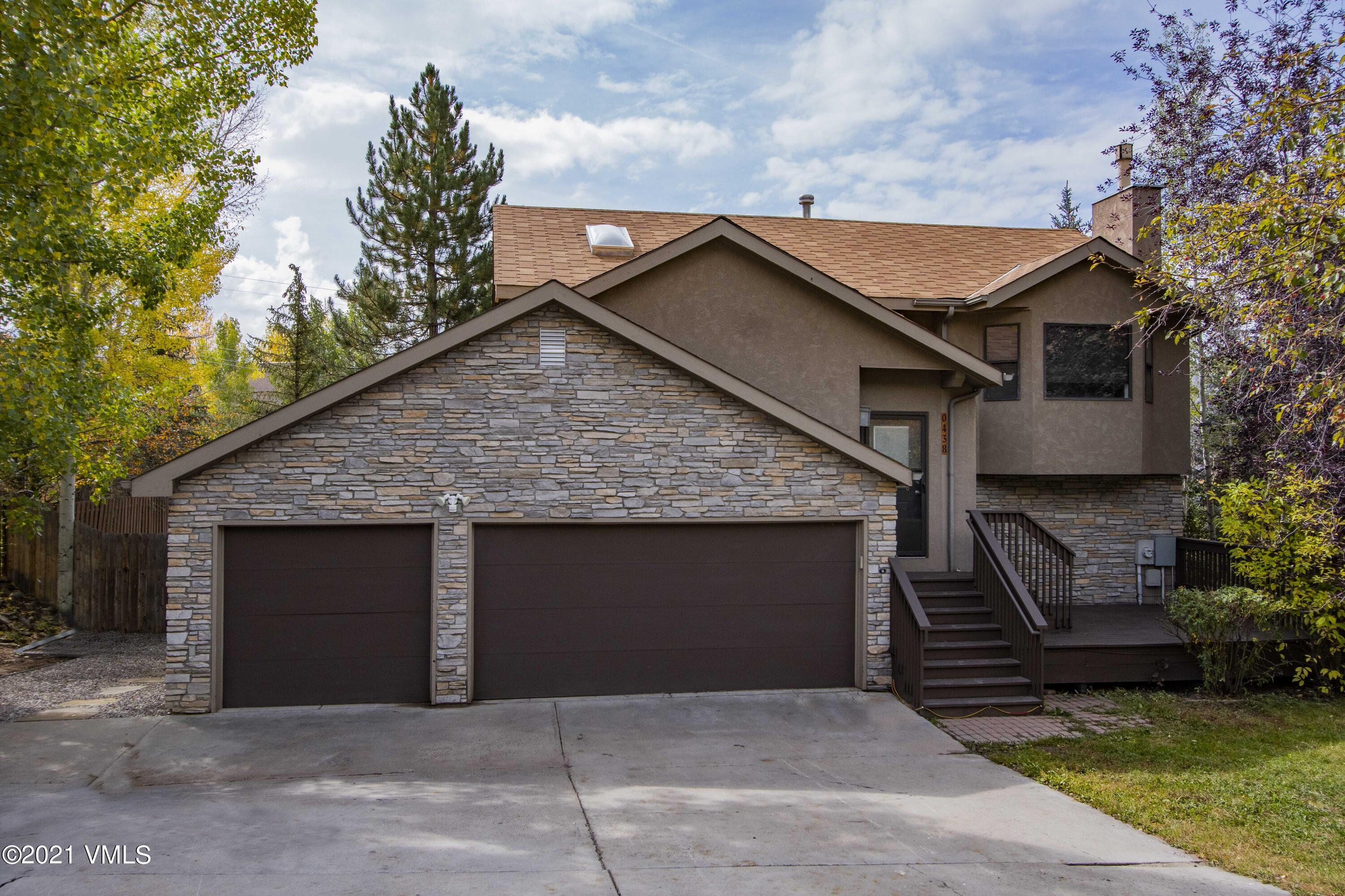 Wonderful opportunity to own a single family home in Edwards with a 3-car garage. Featuring a master bedroom with incredible closet space, a lock-off on the middle level, and gorgeous landscaping with mountain views from multiple decks. Lower level walks out to another deck with a hot tub. Located right next to Berry Creek's hiking and bike trails.