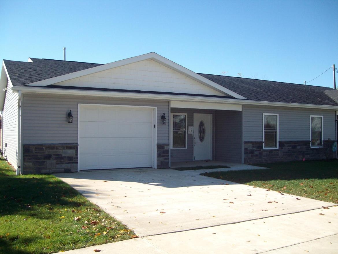 Brand new!  Great location near downtown.  Open floor plan.  Stainless steel appliances.  Two bedrooms; two full baths.  Upgrades throughout.  Laminate flooring in gray tones.  17x22 attached garage.  Why rent when you can own for less?