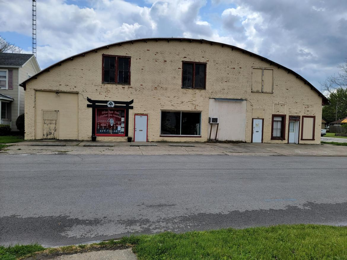 This building has housed many businesses over the years. It currently rents to a martial arts studio, cultural center, car mechanic & storage area. Monthly income at this time is approx $1,000 with all renters on month to month. Renters pay their own utilities & make most of their own repairs. Seller states there is a newer roof on west side & south side. Current renters wish to stay at this time. Please do not interfere with businesses. Contact a real estate agent to arrange tour of the rentals.